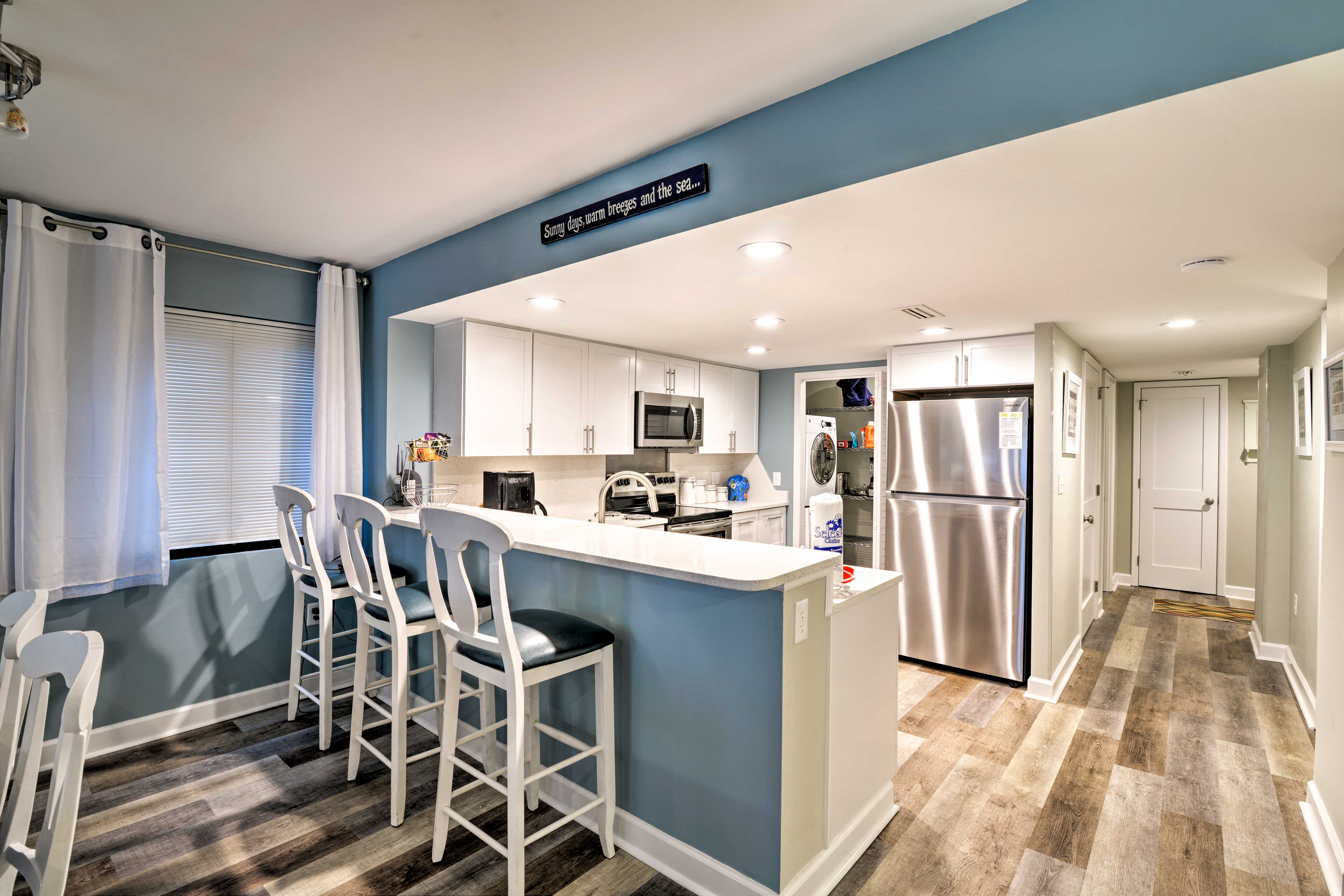 See what's cooking in the kitchen at the breakfast bar with seating for 3.