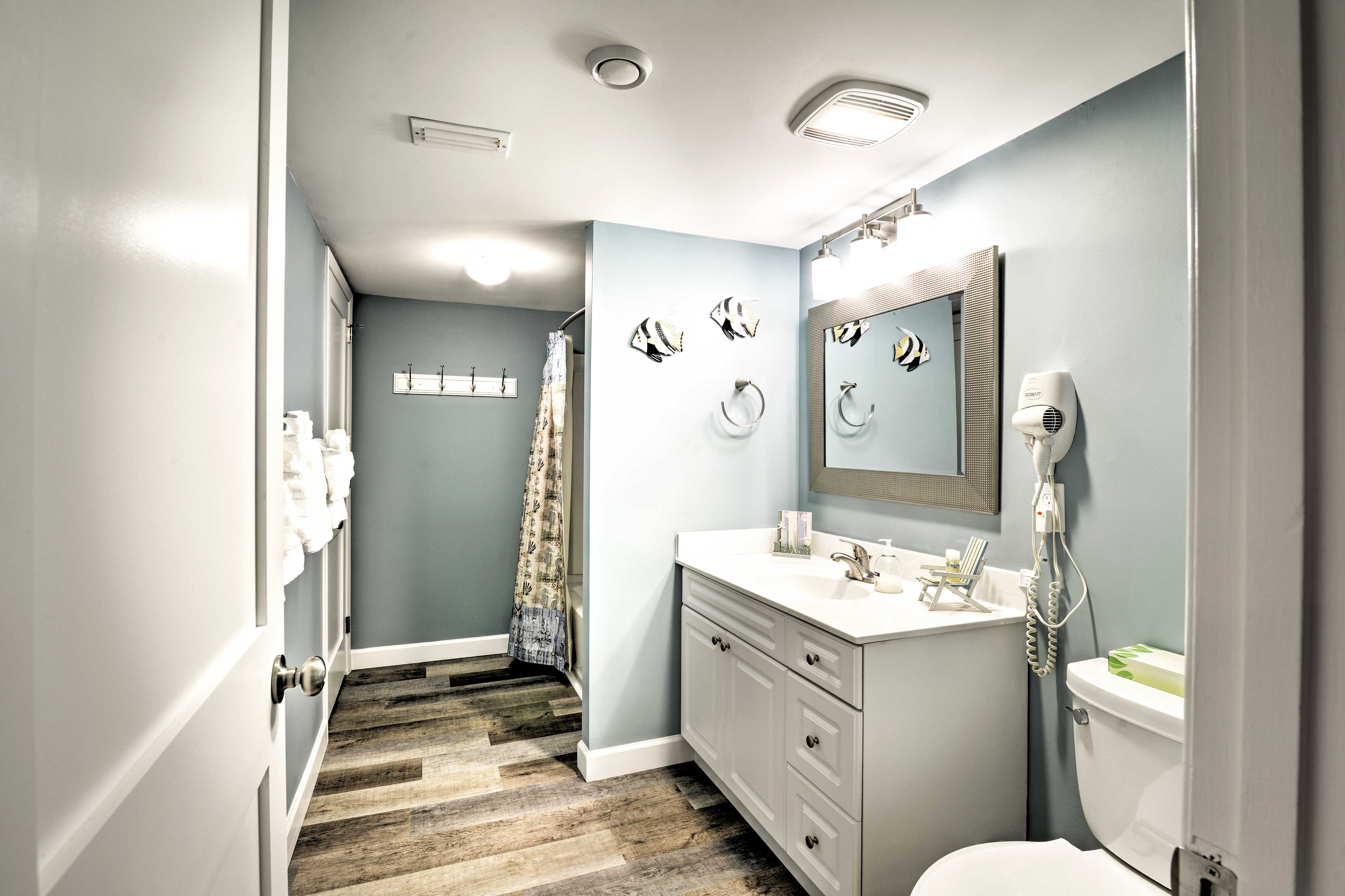 The second full bathroom has a shower/tub combo and a hairdryer.