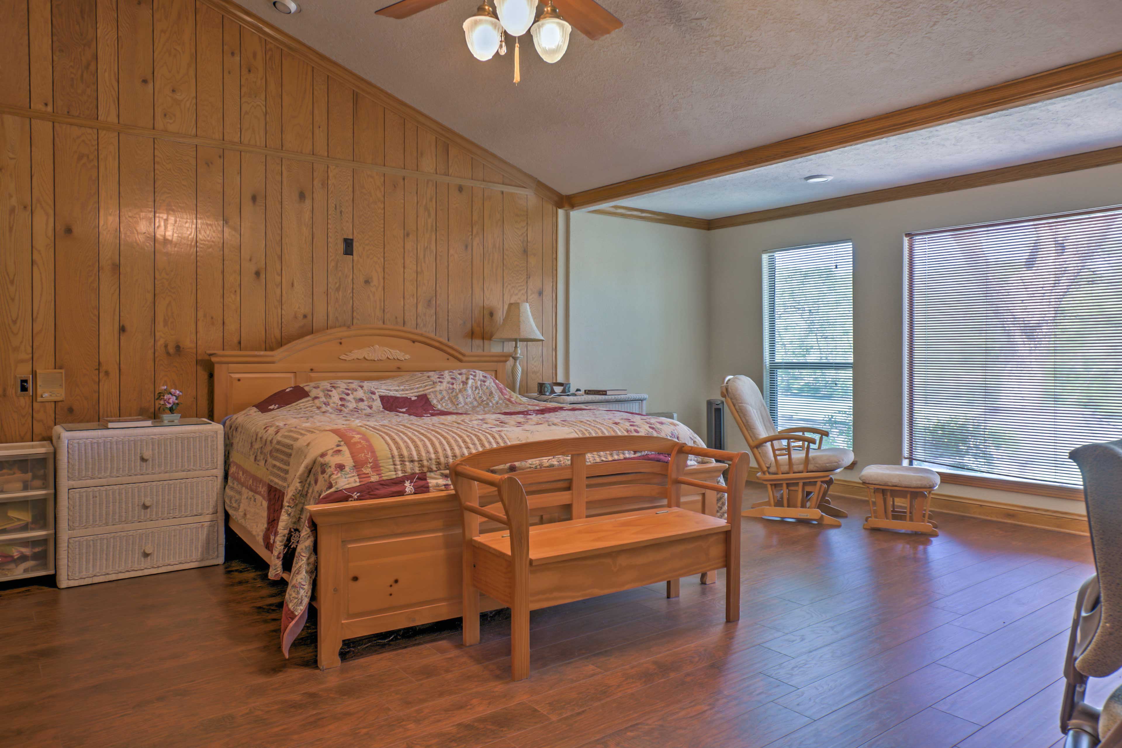 This master bedroom features a king-sized bed stunning lake views!