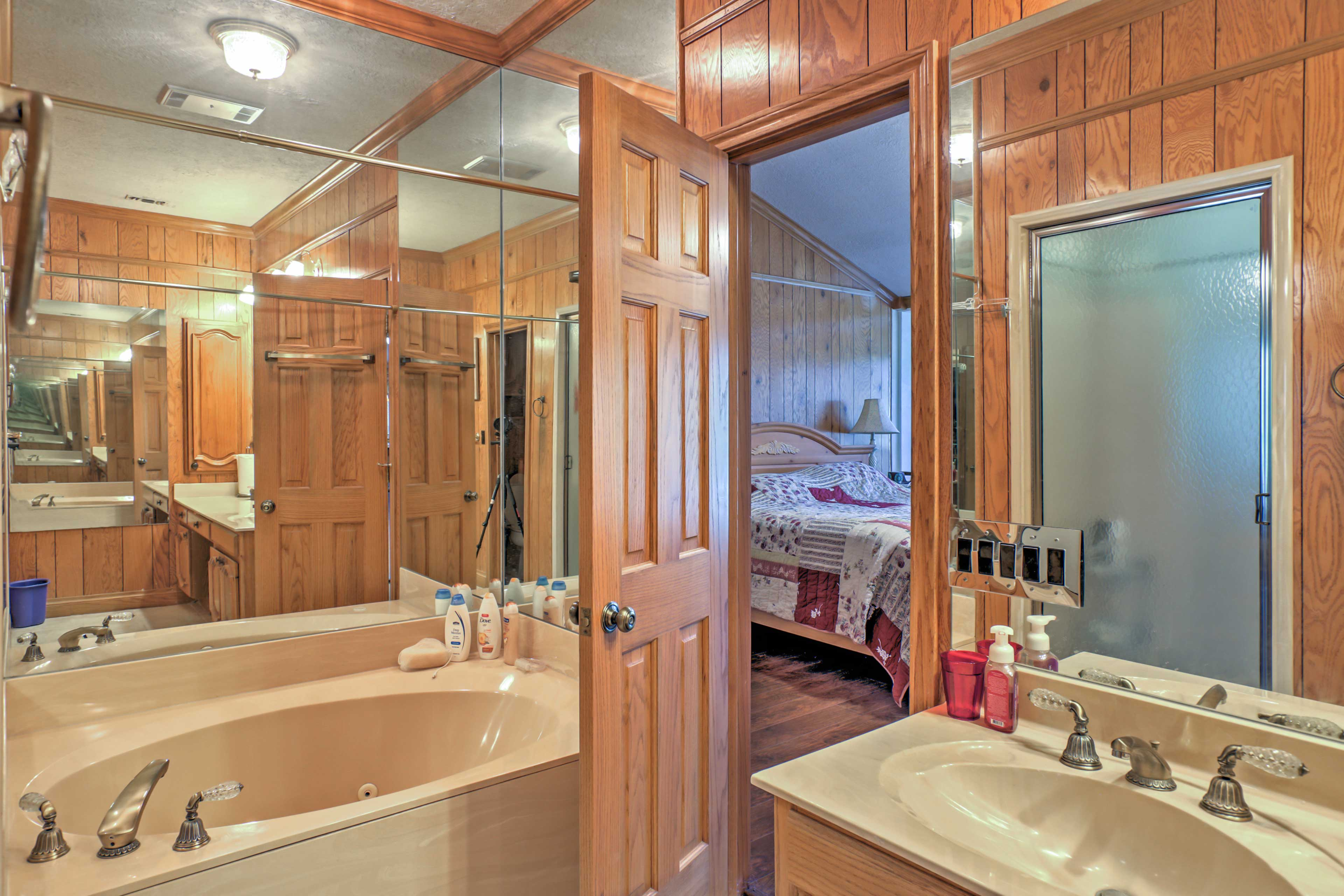 This bathroom features a large tub and single vanity.
