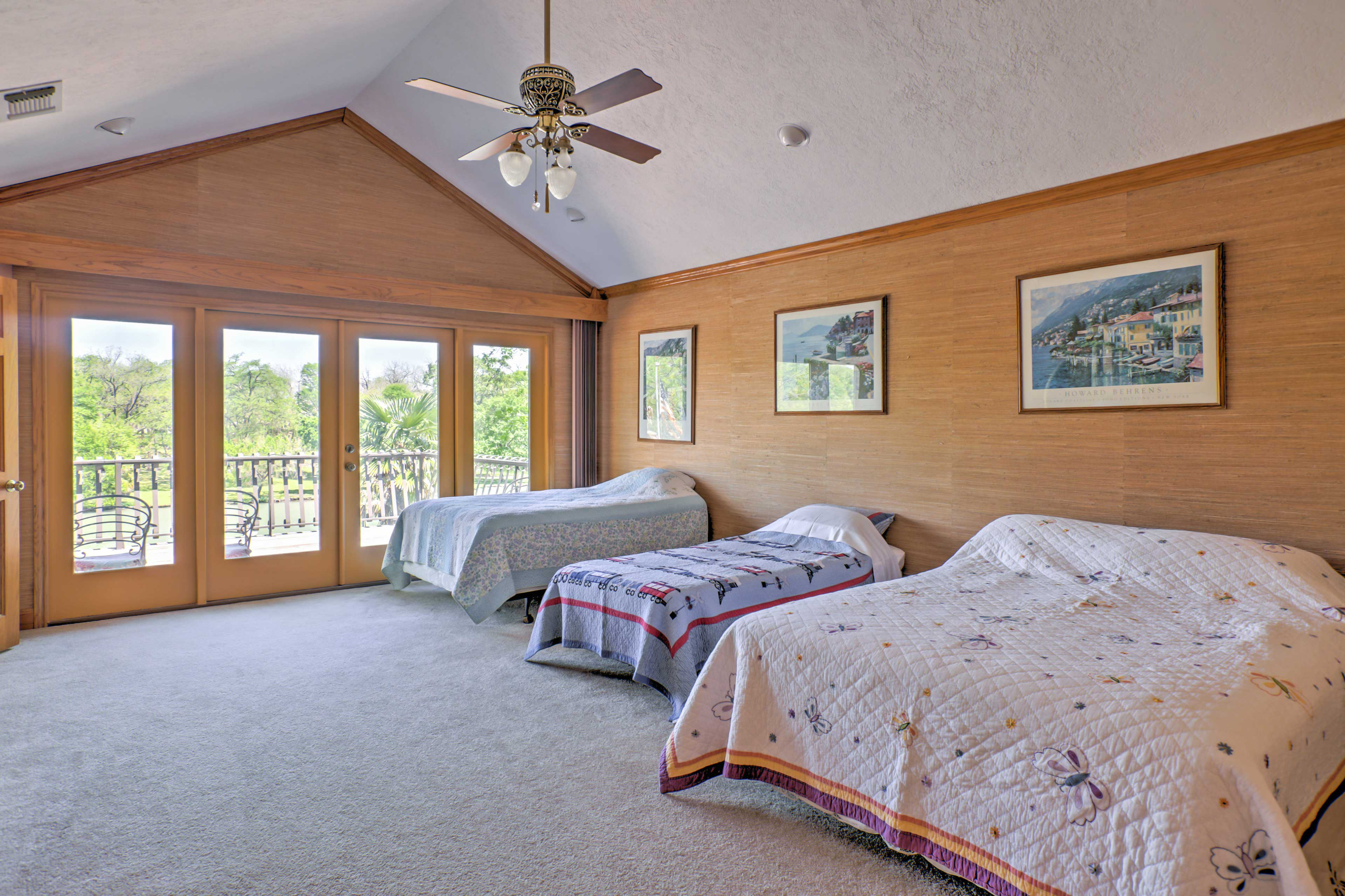This room features a queen bed and 2 twin beds.