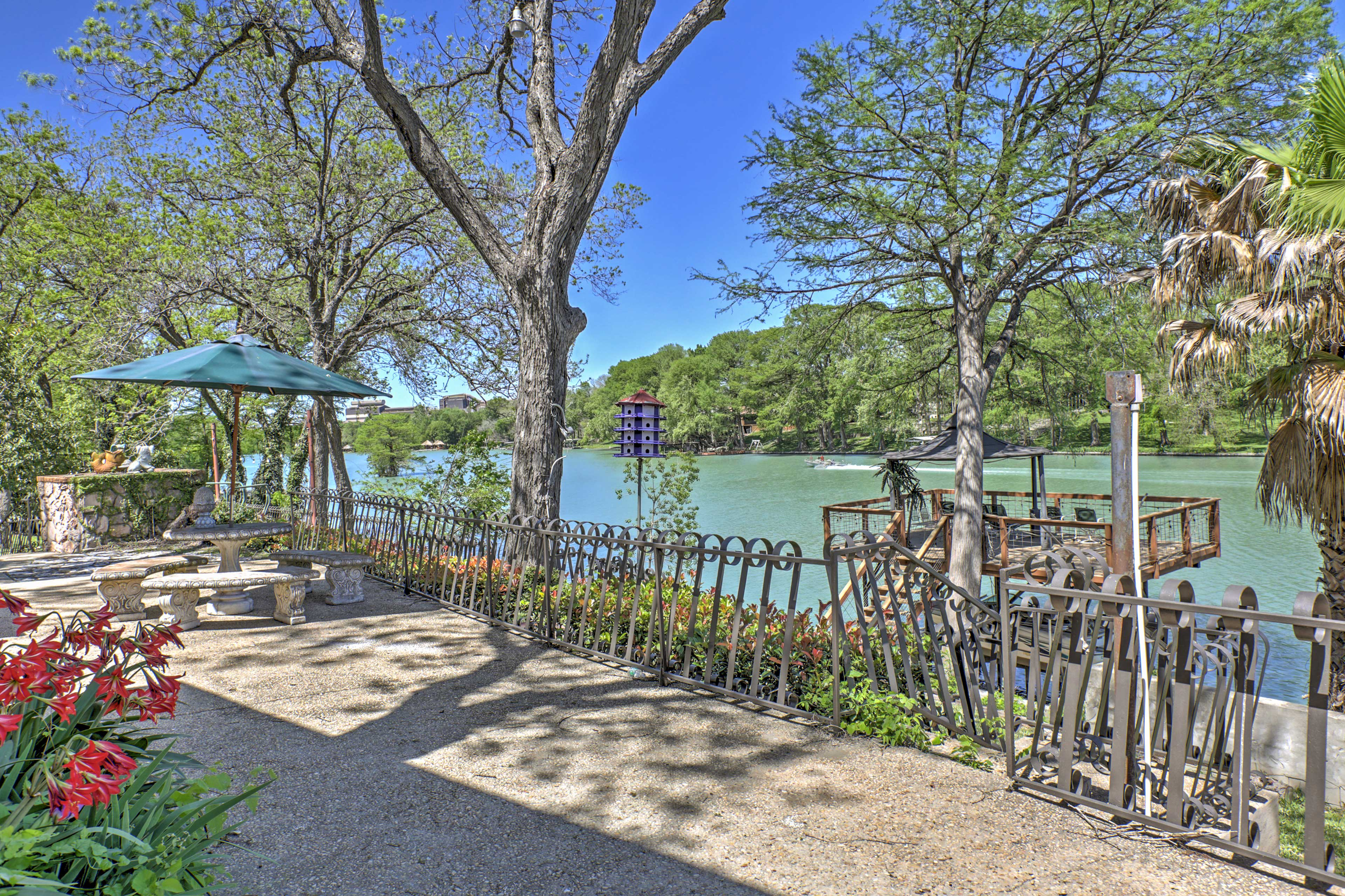 Relax at this lakefront 4-bedroom, 3-bath vacation rental home in Seguin.