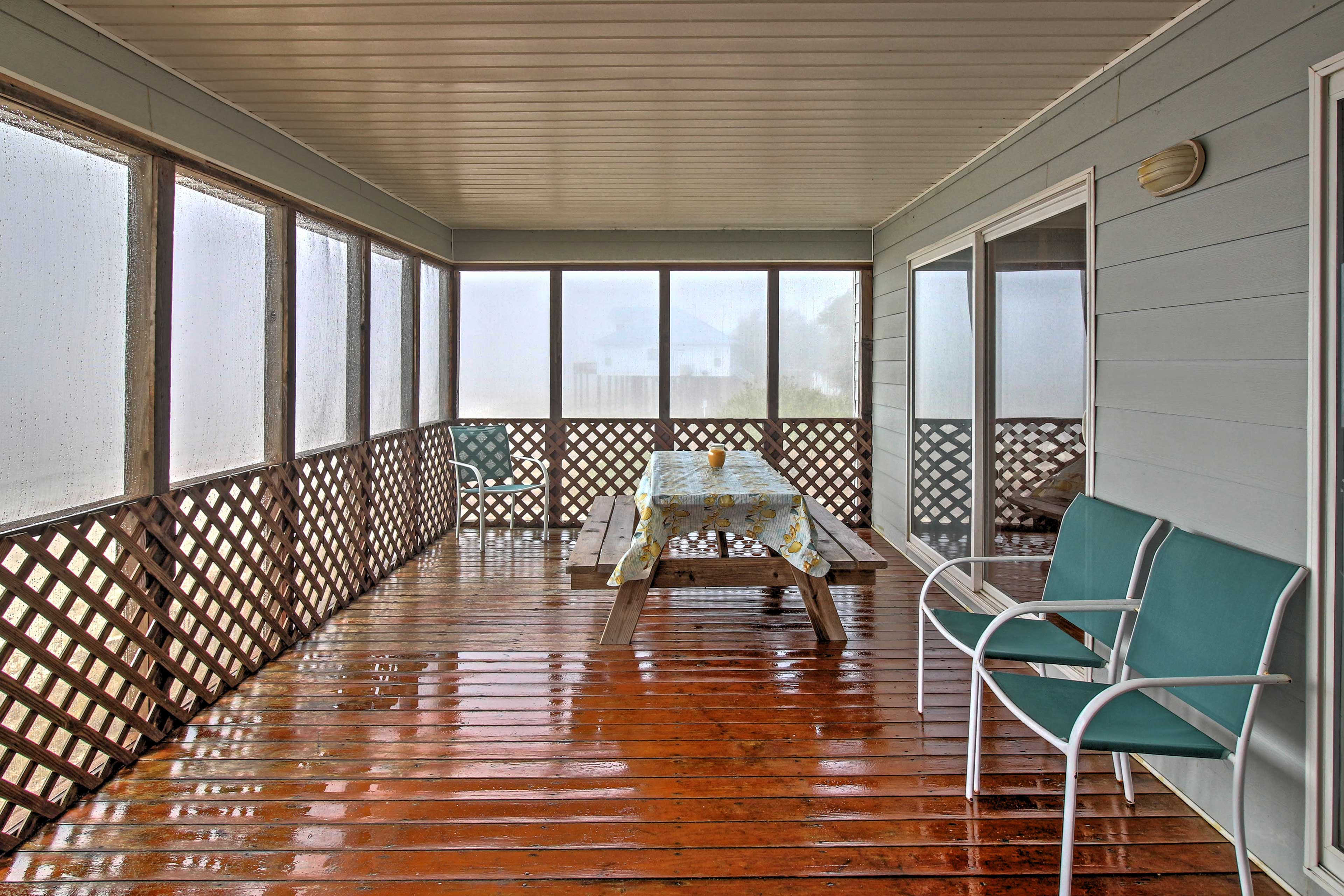 Sip on a fresh brew of coffee on the screened-in deck.