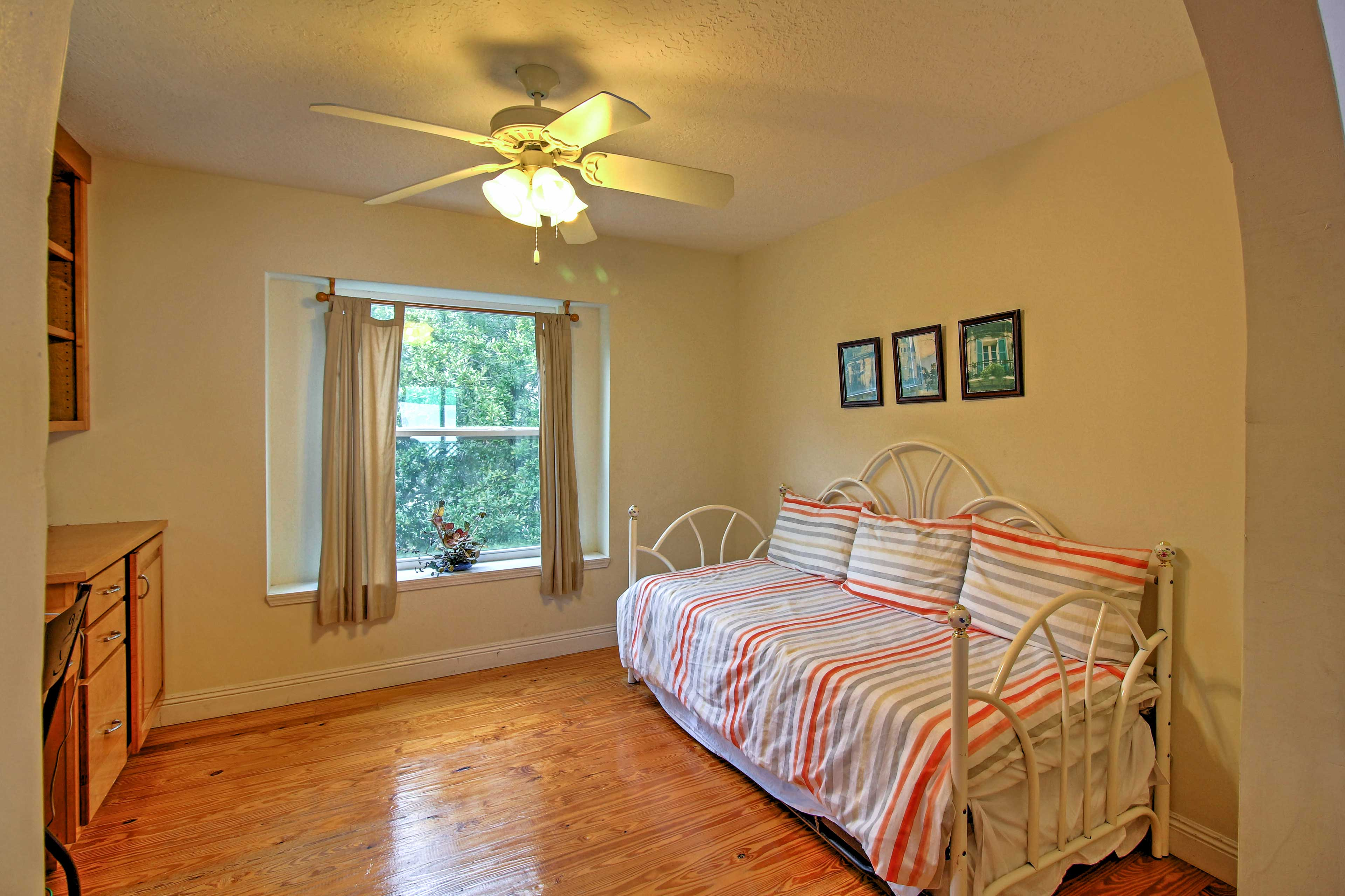 The office area features additional sleeping, including a hidden trundle bed underneath.