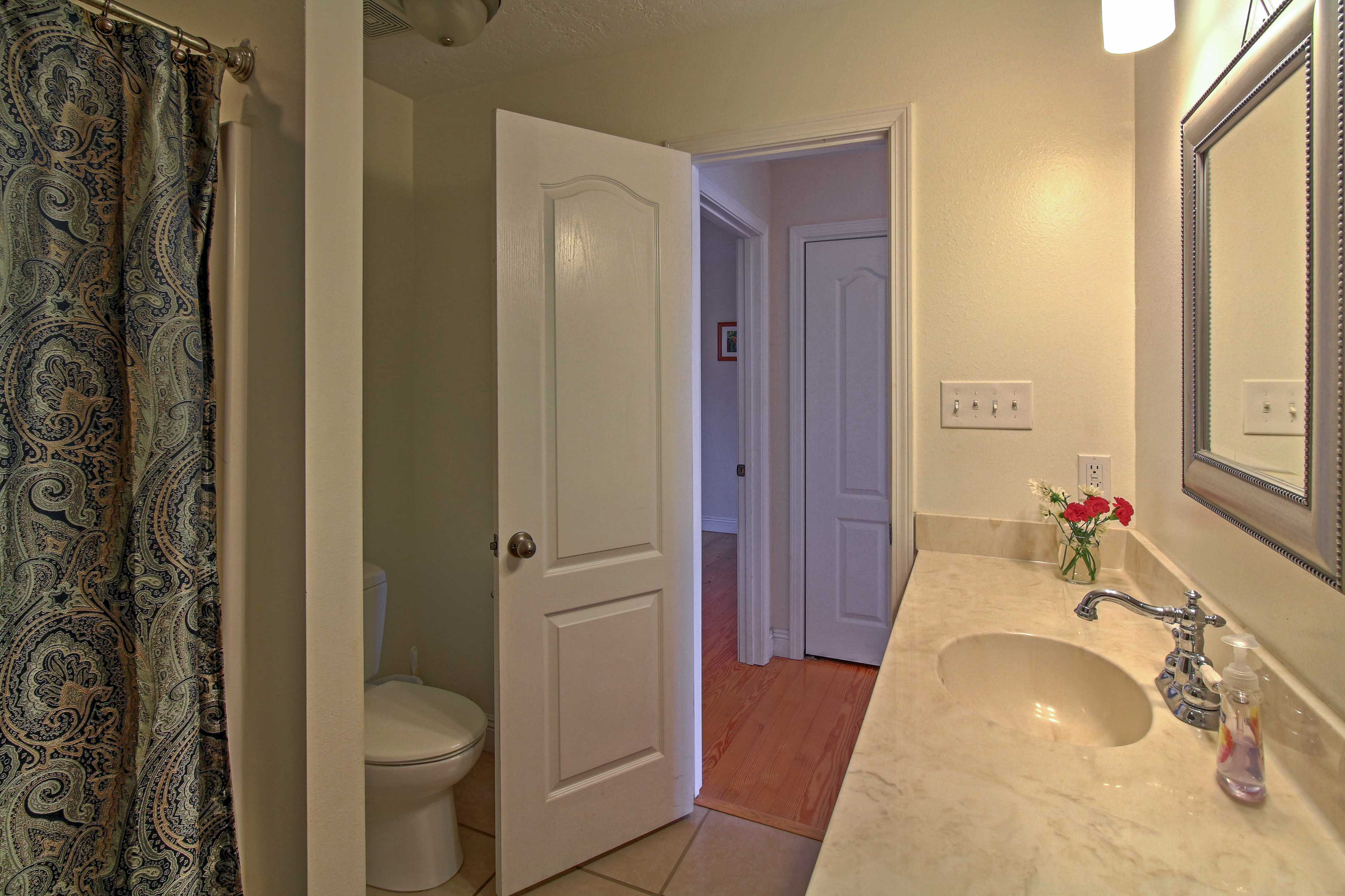 Freshen up for a night on the town in this cozy hallway bathroom.