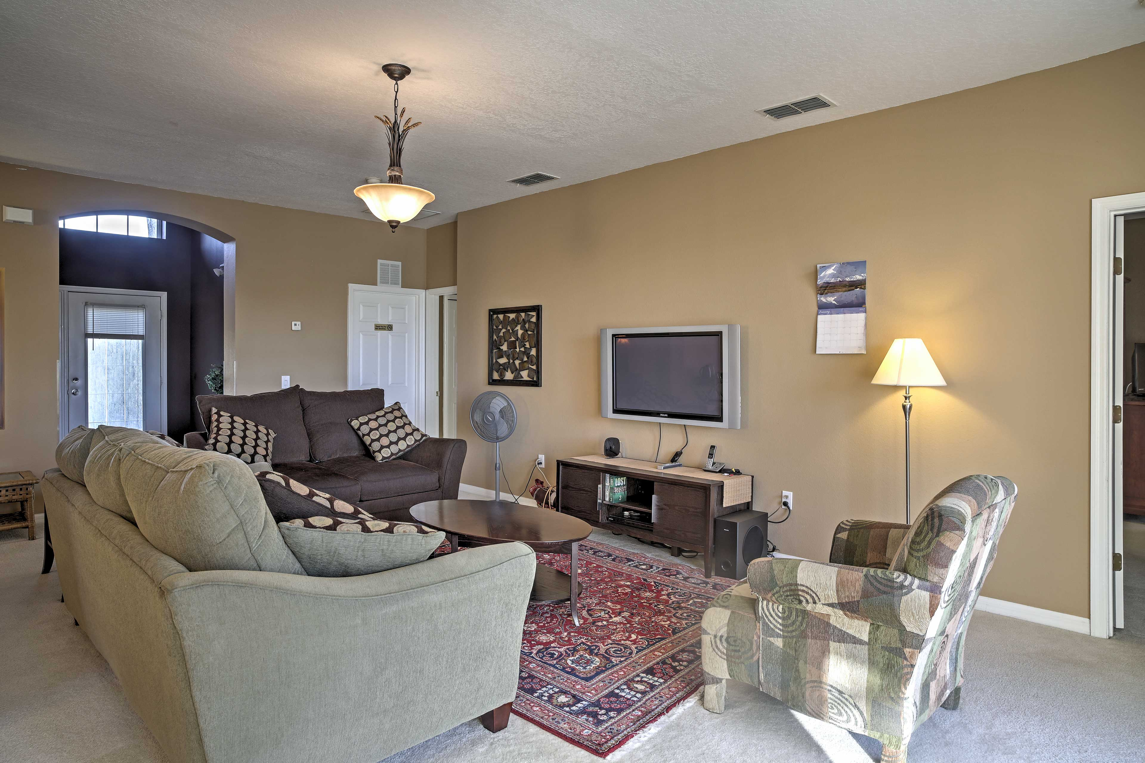 Curl up on the couch and watch the news on the 48-inch flat screen TV.