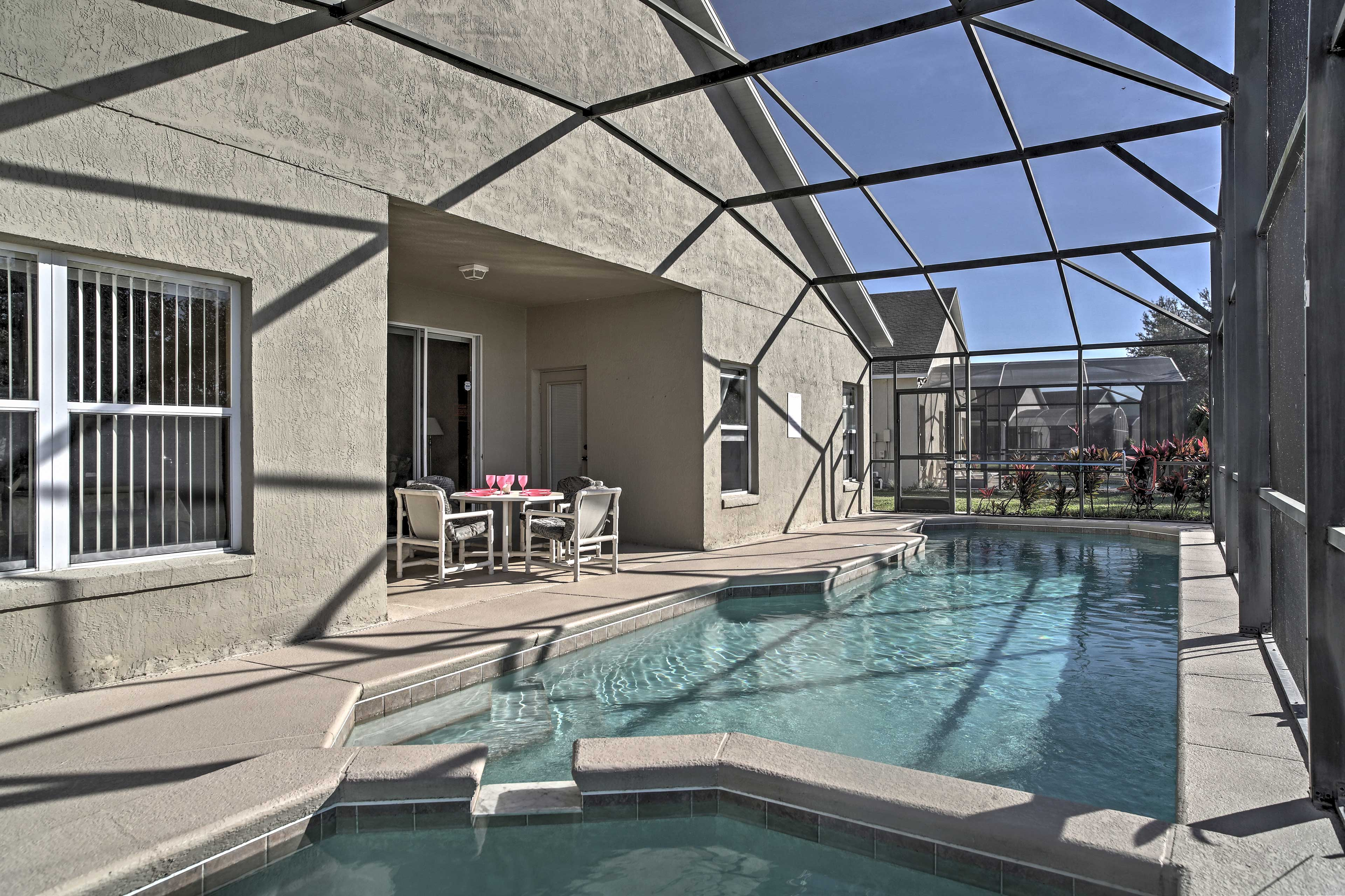 Enjoy balmy afternoons splashing around in the private screened-in pool.