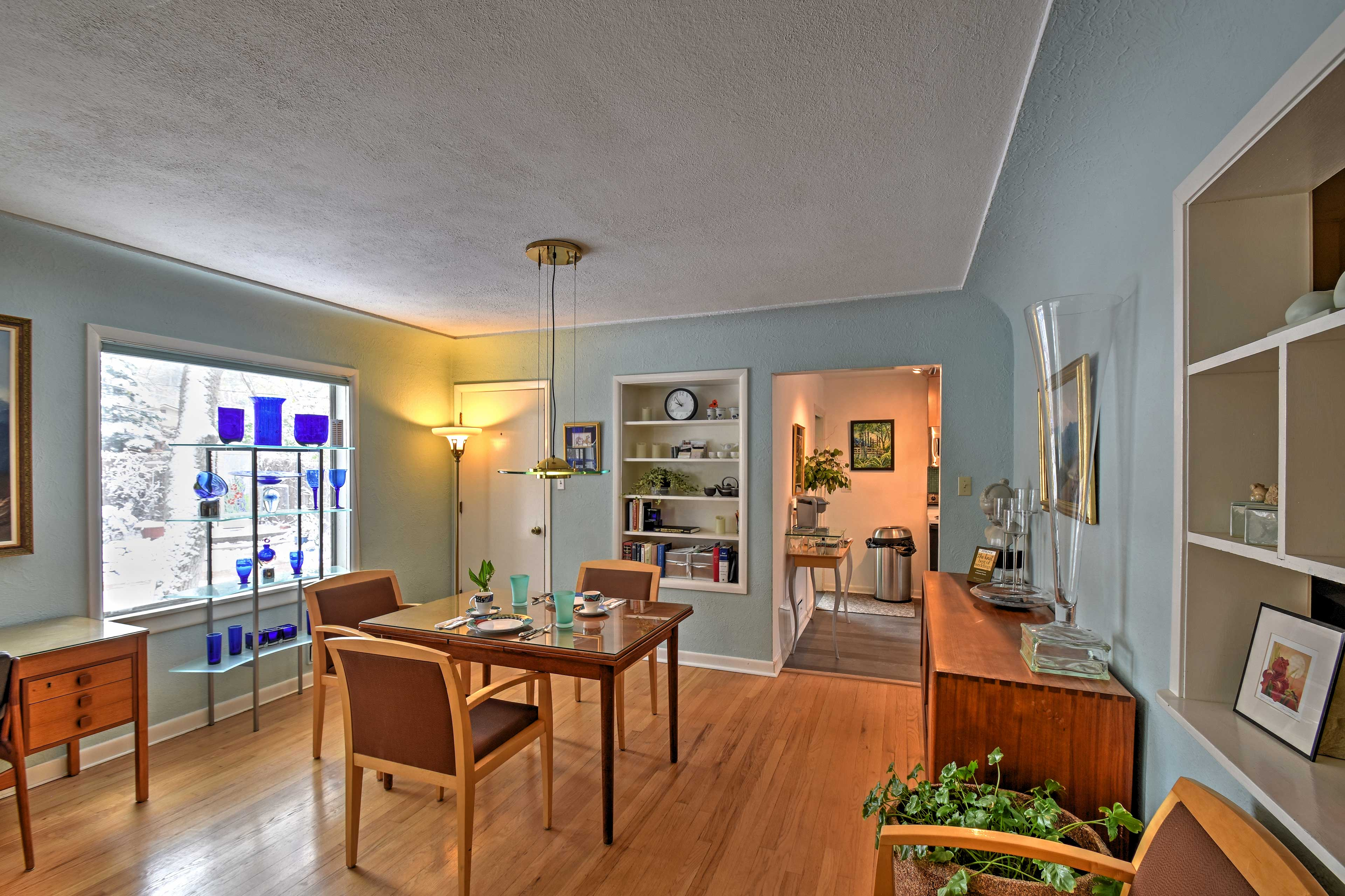 Enjoy meals from the dining room table as natural sunlight fills the home.