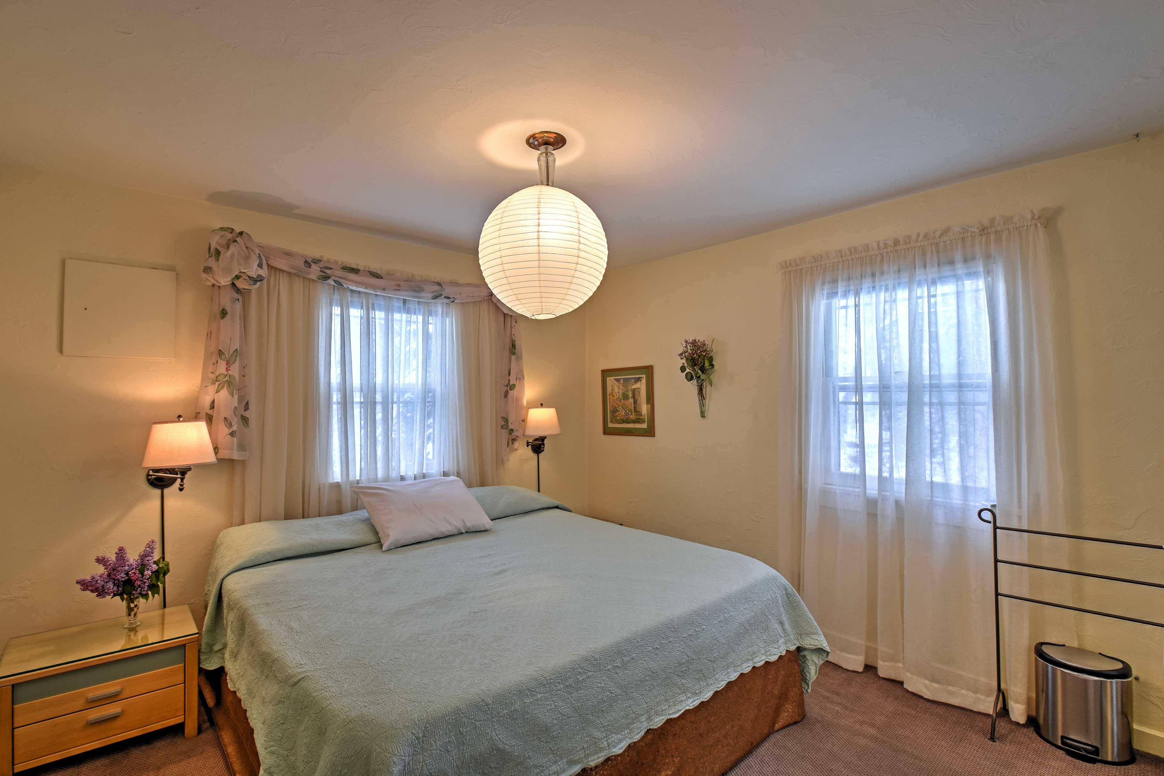 The master bedroom features a king-sized bed with quality linens.