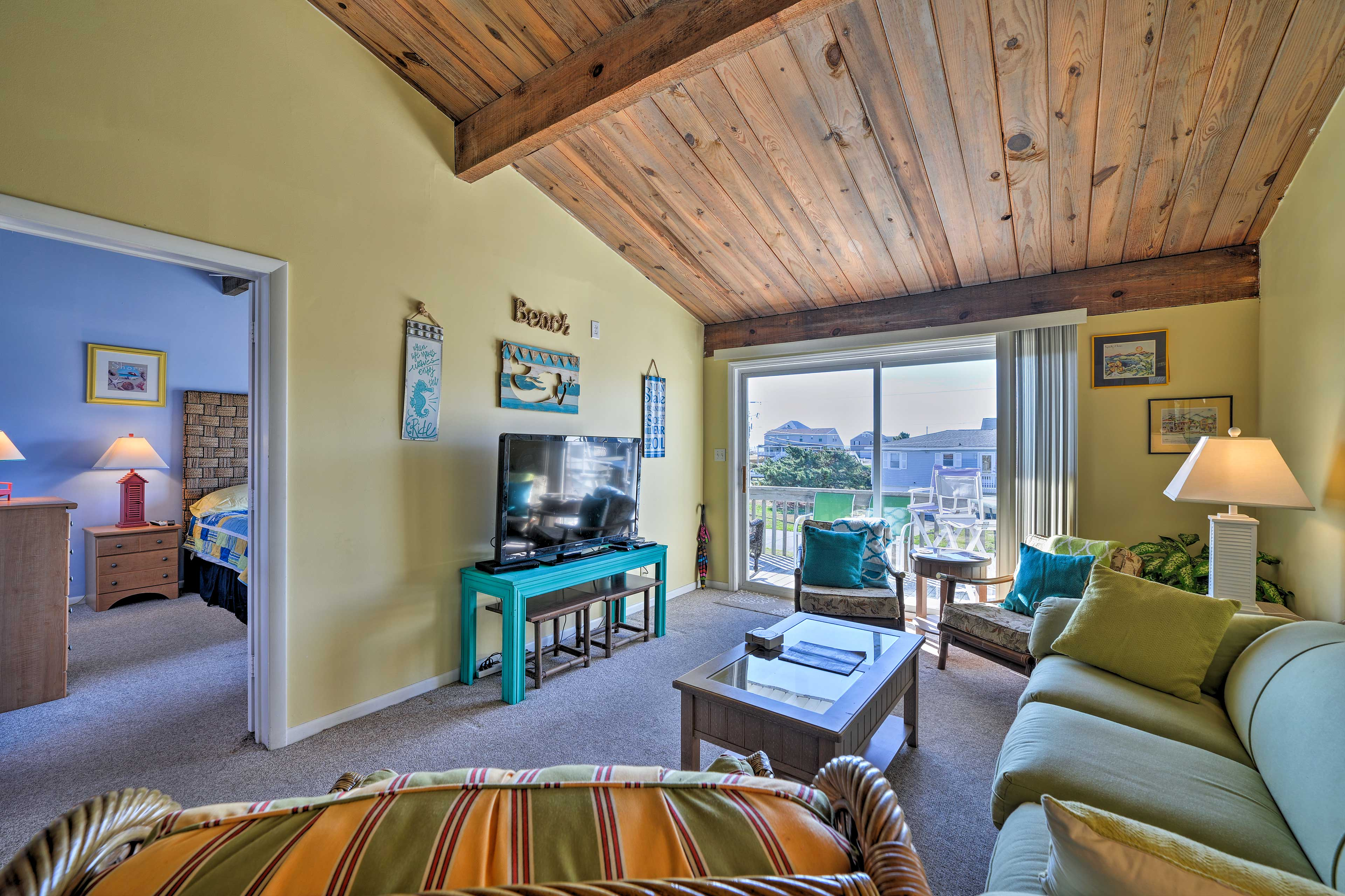 The bright and breezy living area hosts plush couches and a flat-screen.