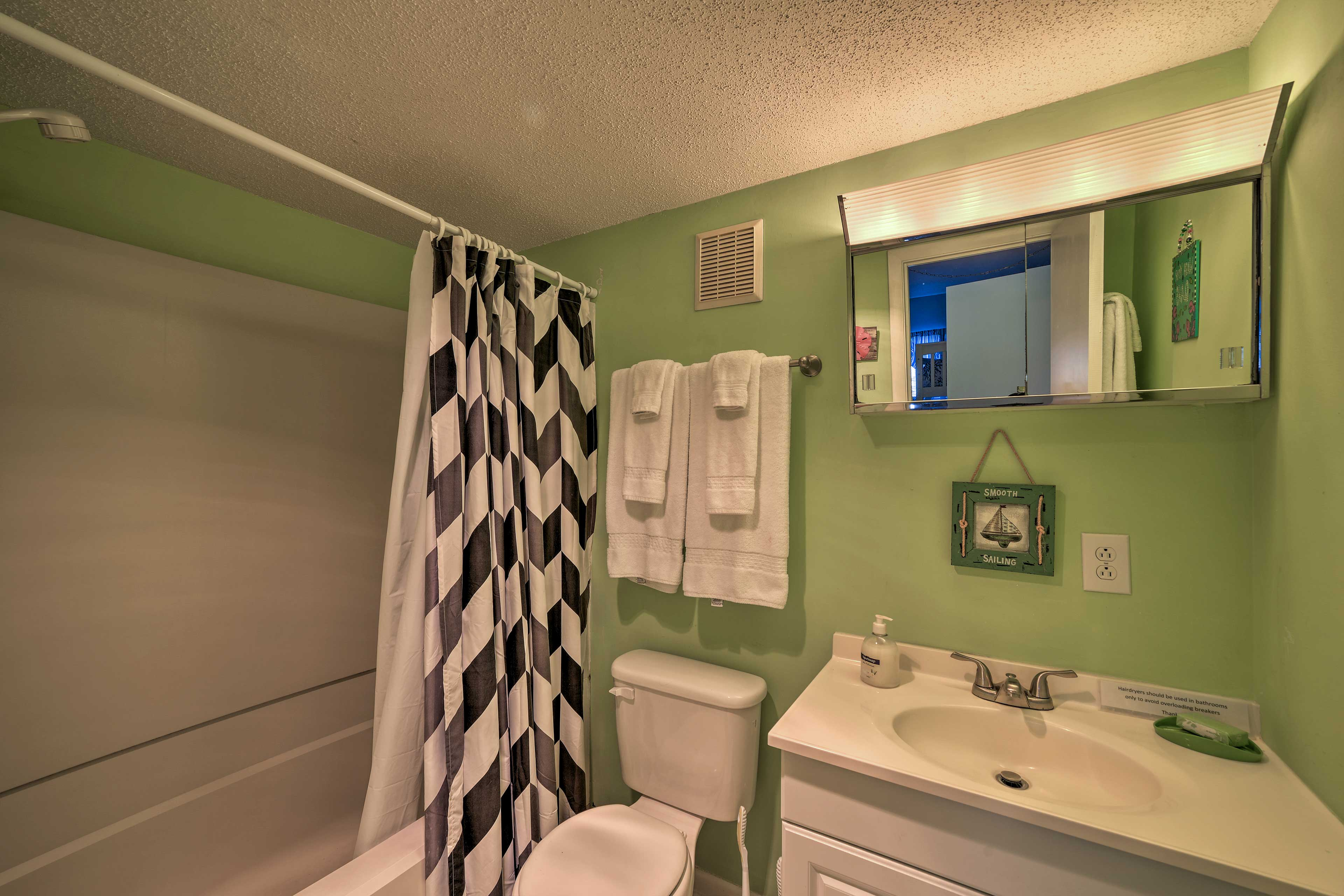 Another full bath w/ shower/tub combo offers space to freshen up.