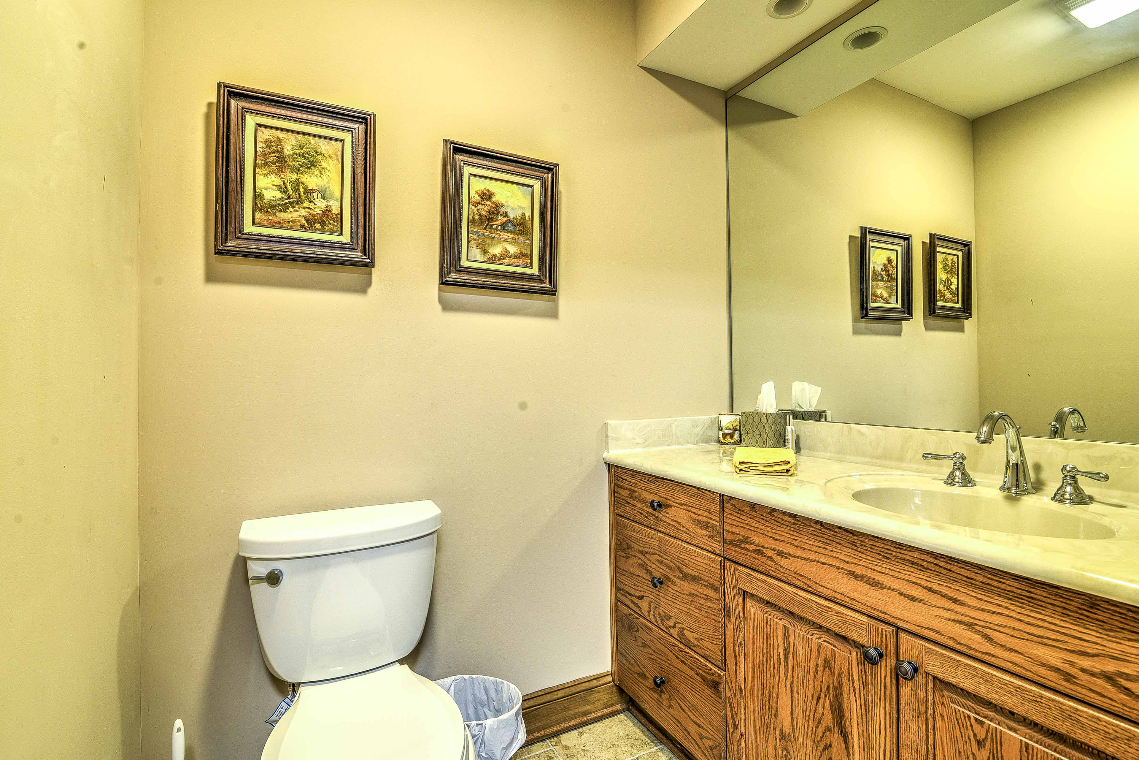 Primp for a night on the town in this pristine bathroom.