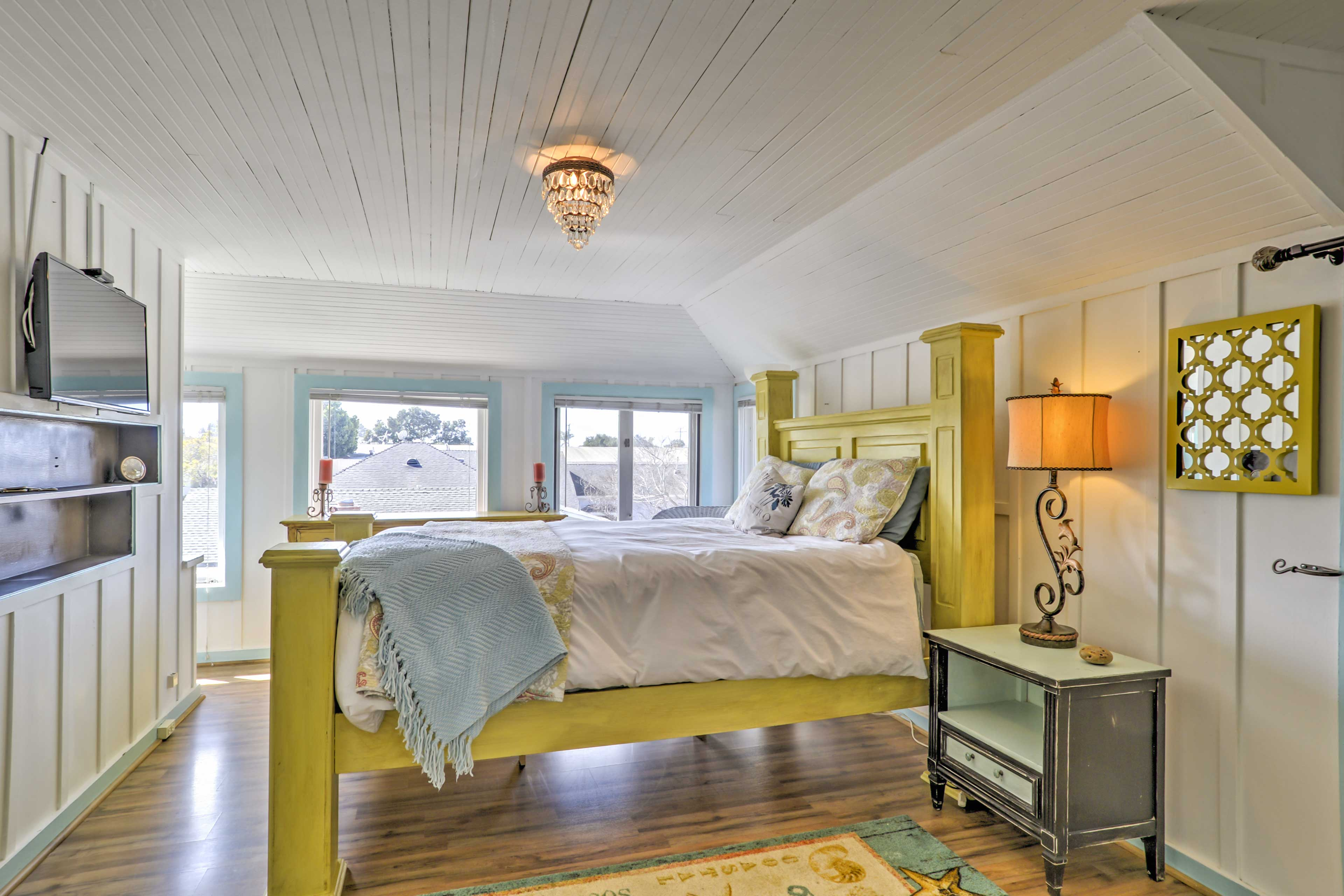 The bedroom offers a plush queen-sized bed.