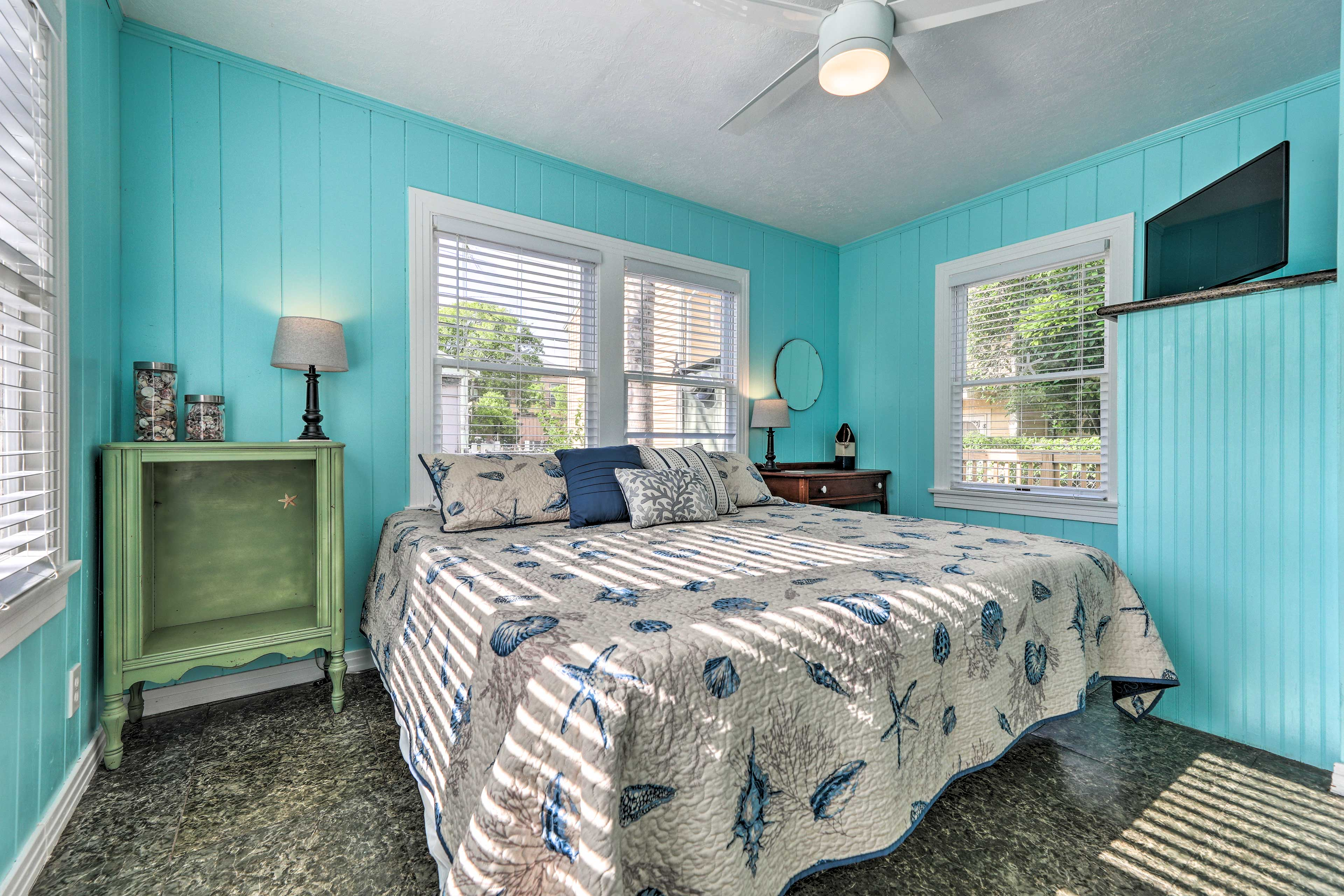 The master bedroom features a king-sized bed.