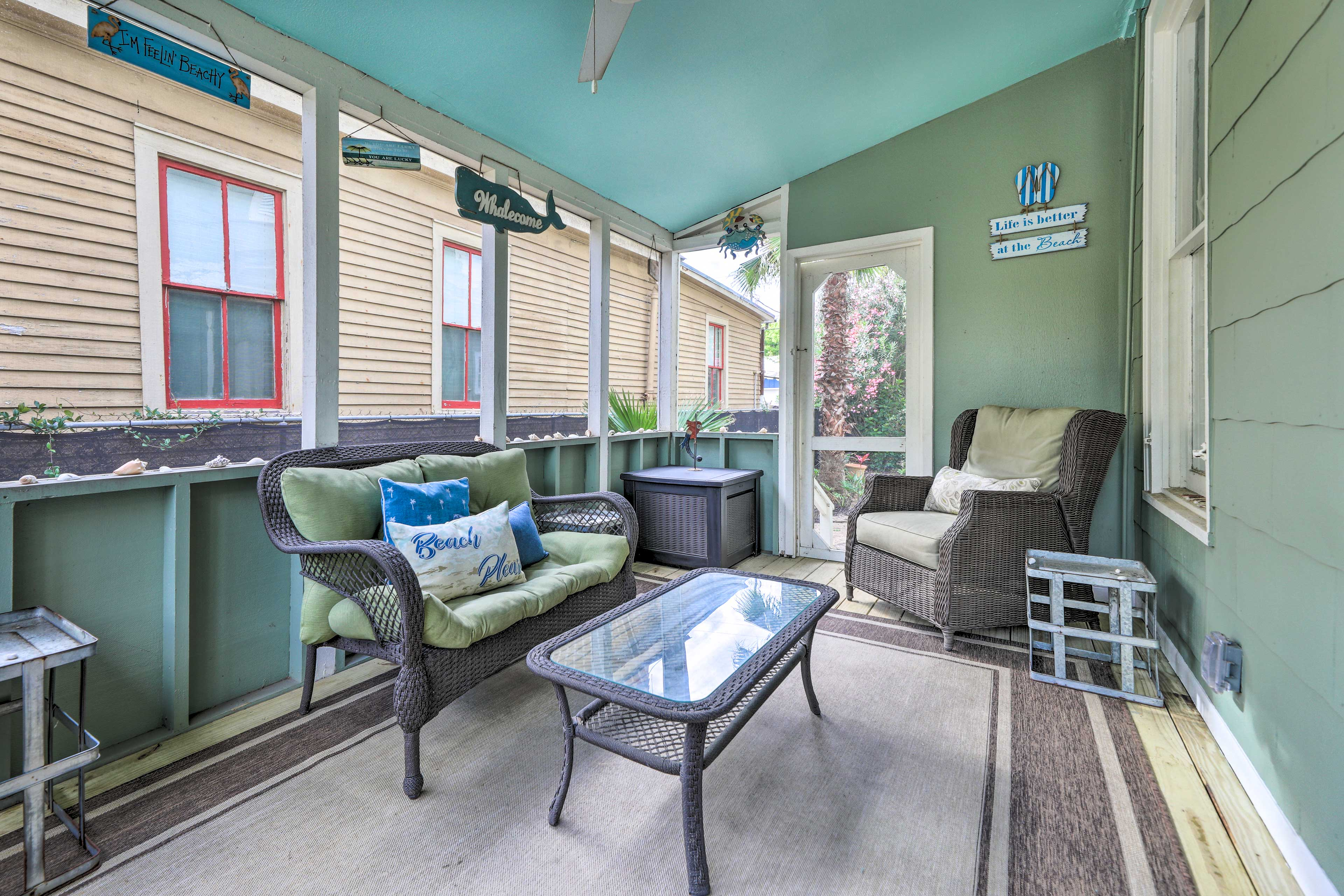 Curl up with a book on the screened-in side porch.