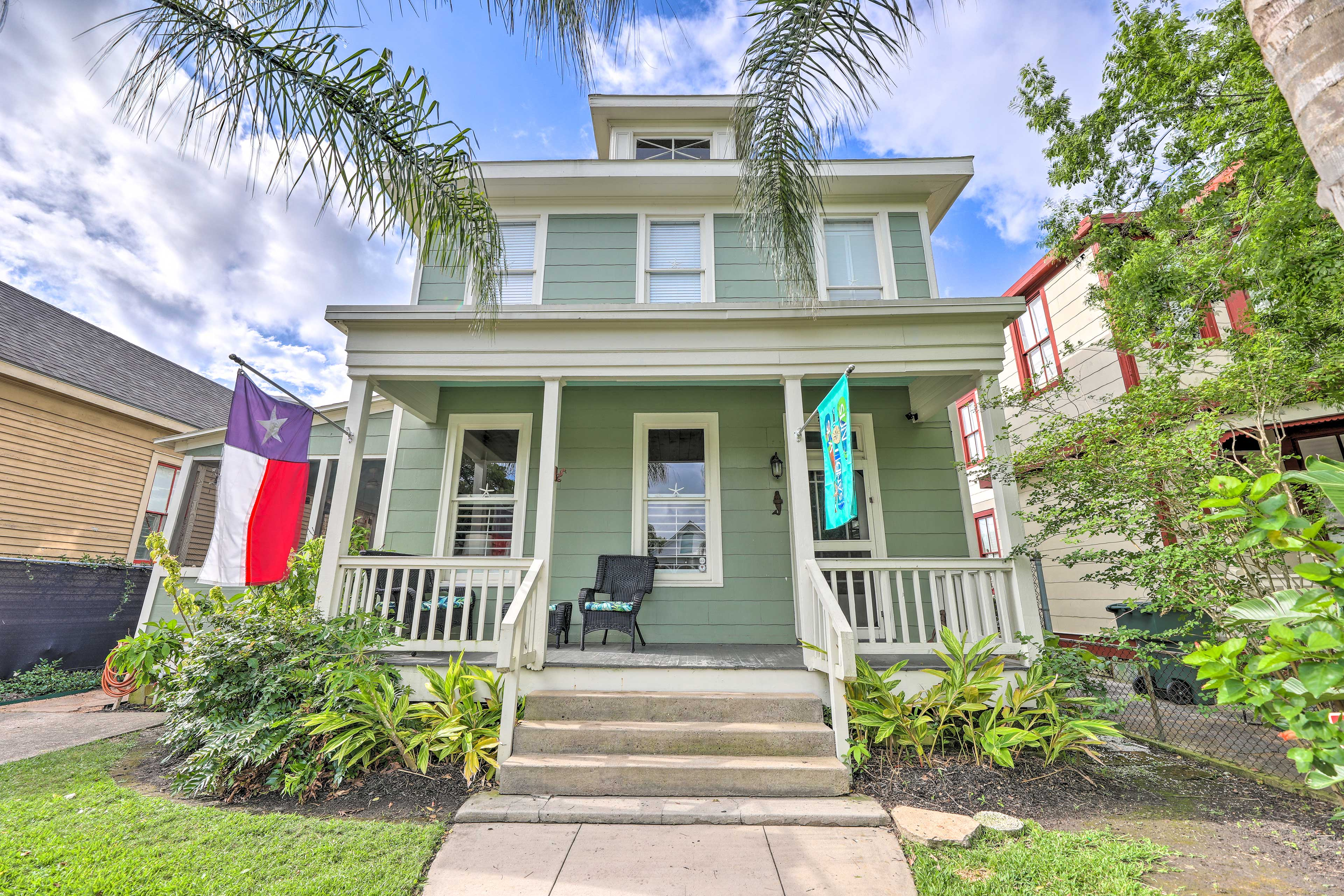 Gather loved ones for a Galveston getaway at this historic vacation rental home.