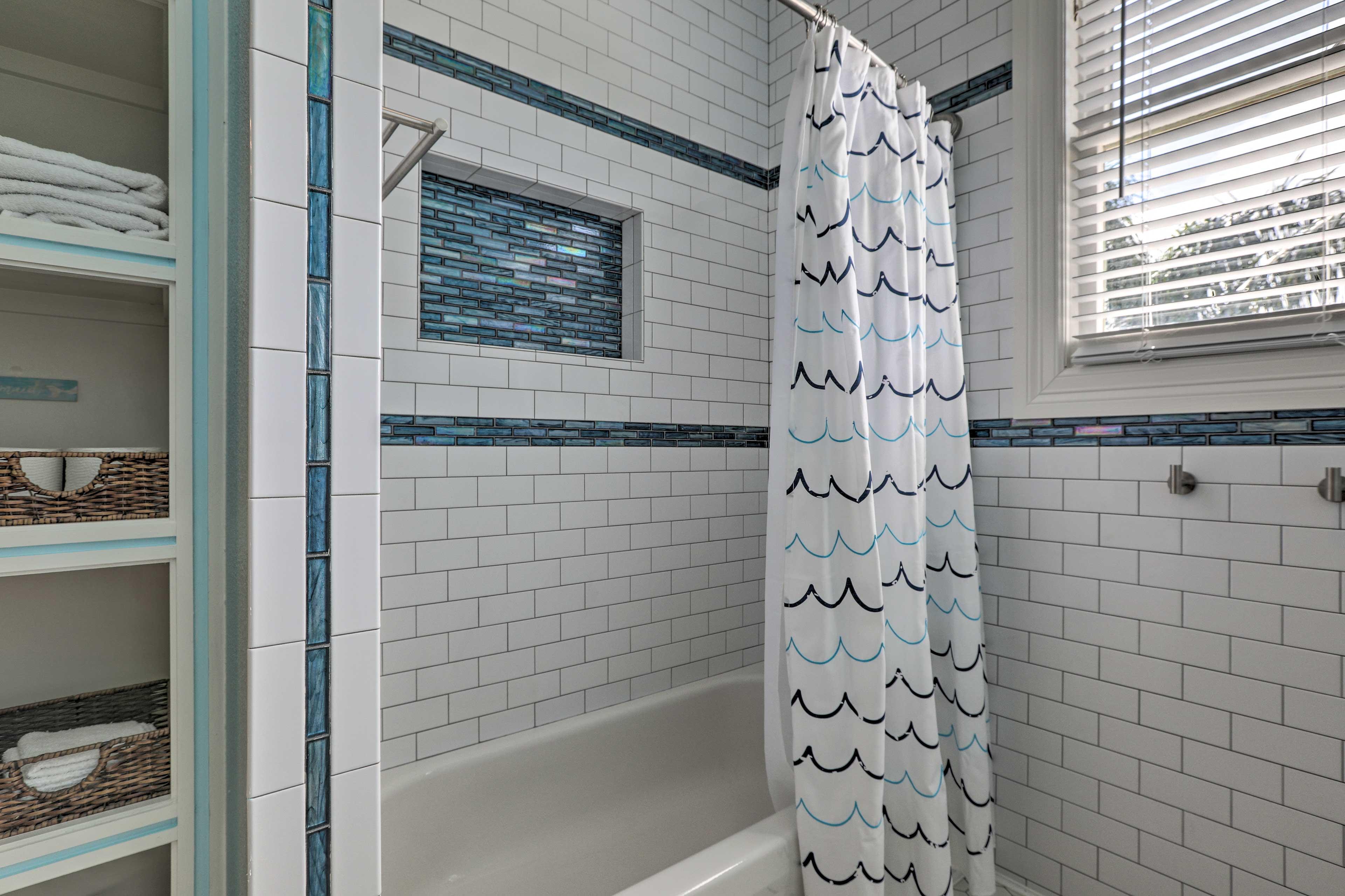 Freshen up in the tile-filled tub/shower combo.