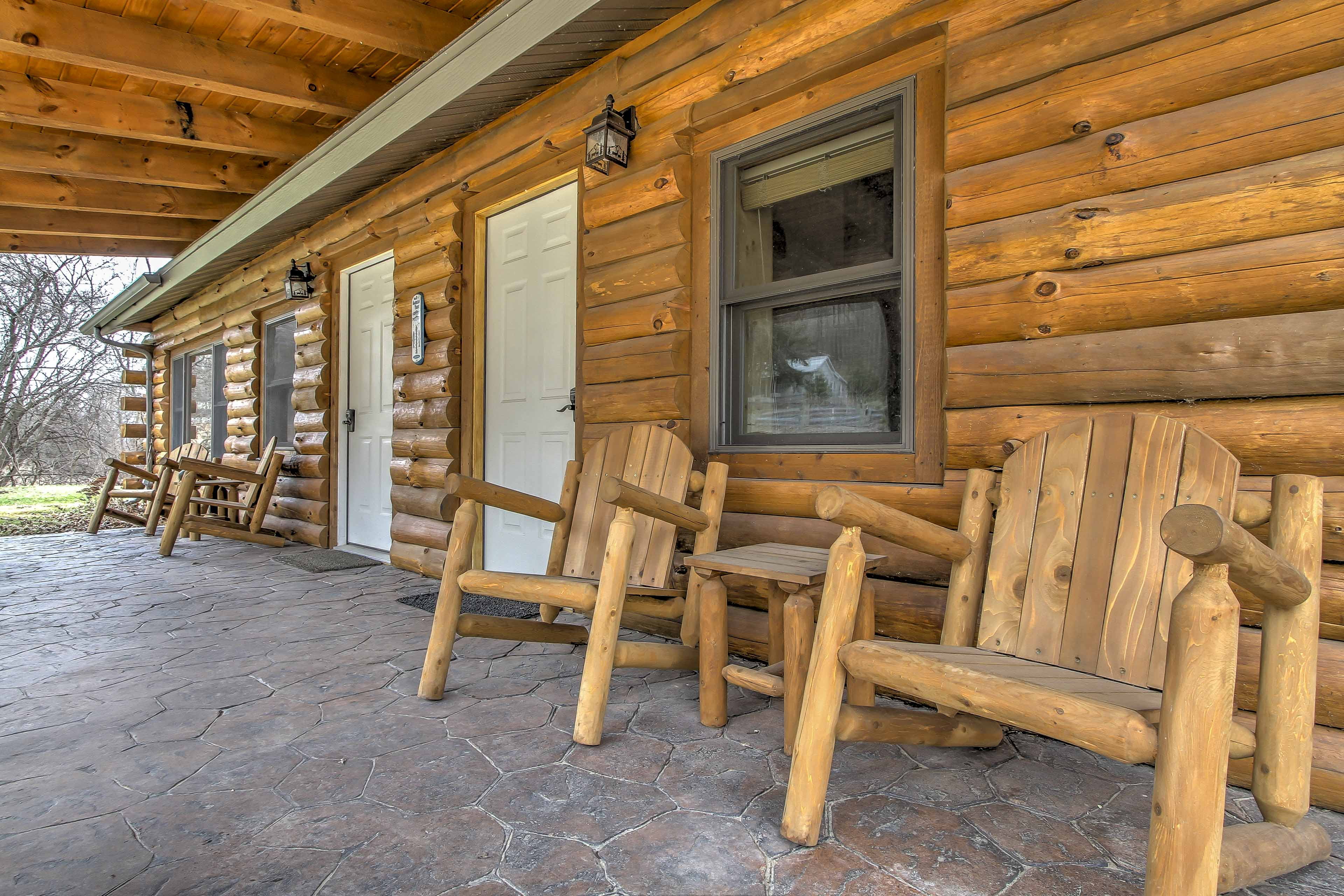 Breathe in the fresh air from the front patio with seating.