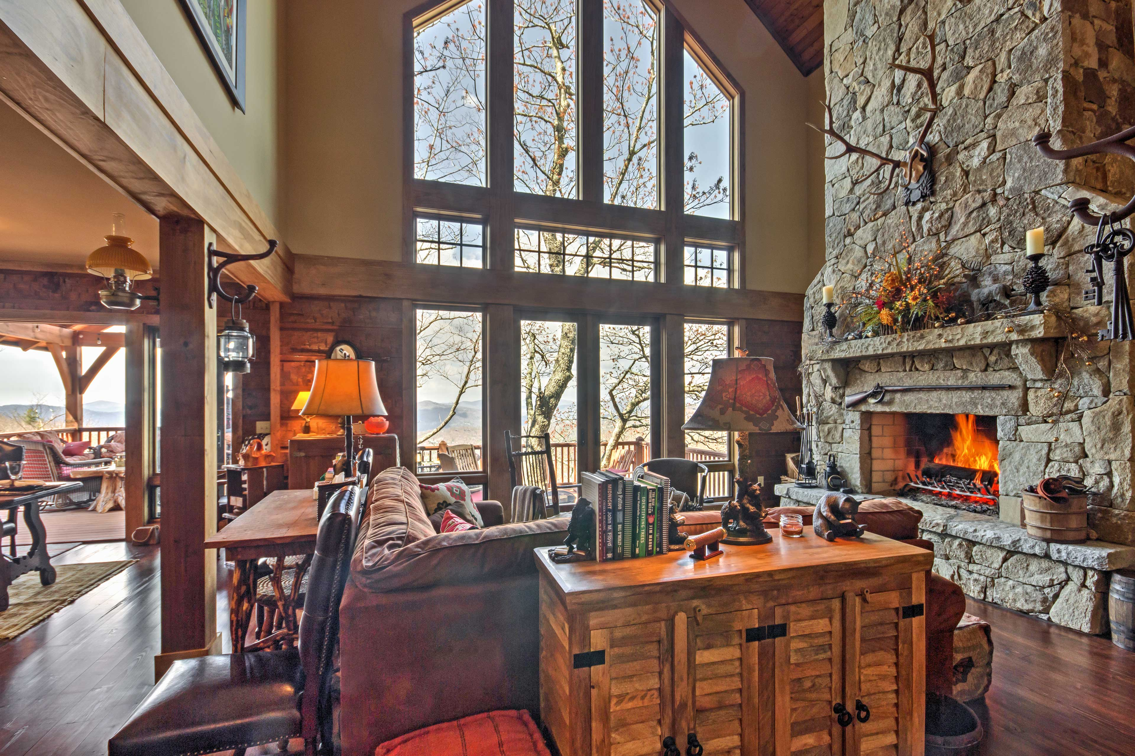 The living room's floor-to-ceiling windows offer mountain views as well!