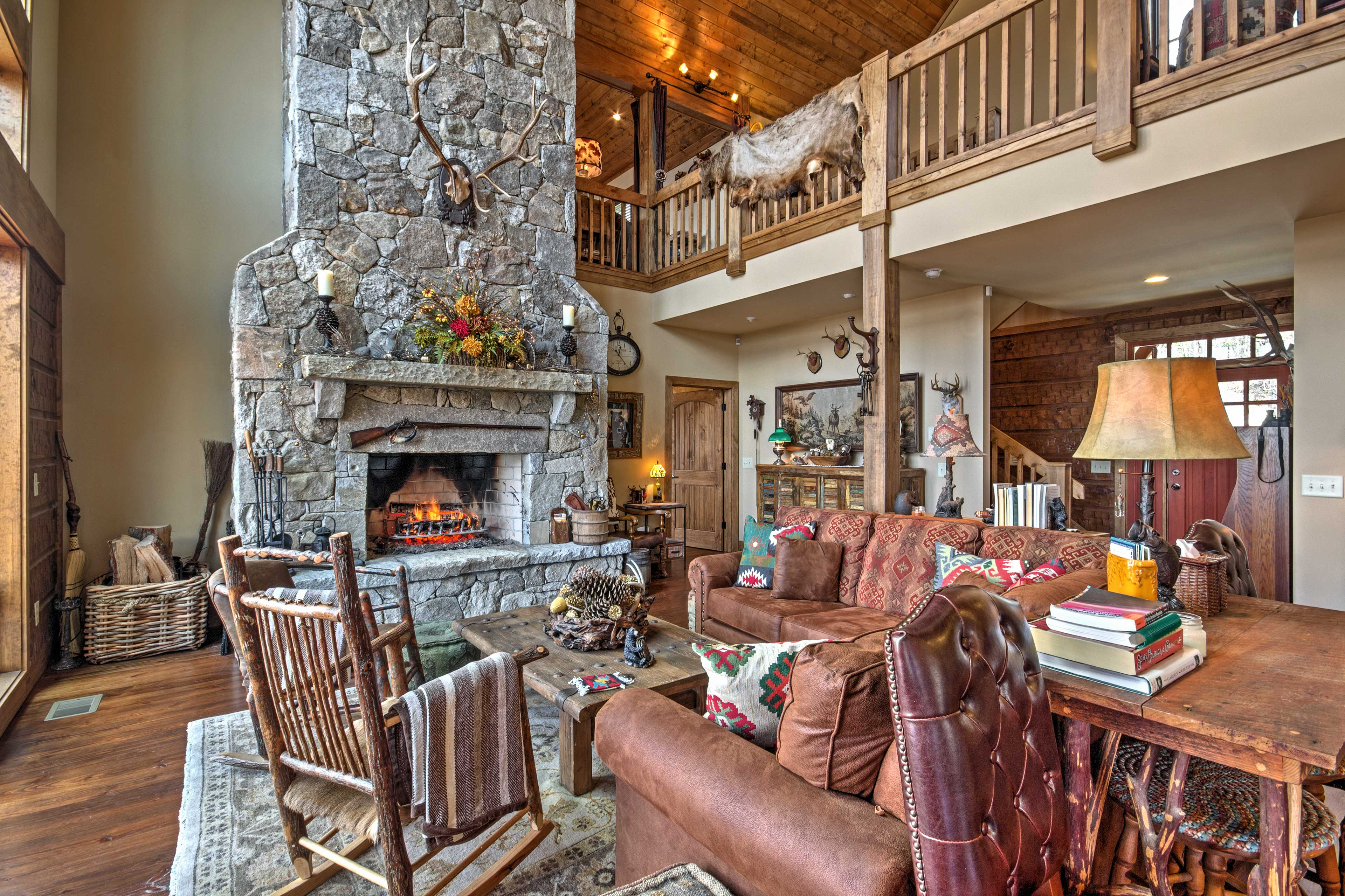 Lounge in the warmth of the wood-burning fireplace in the main living area.