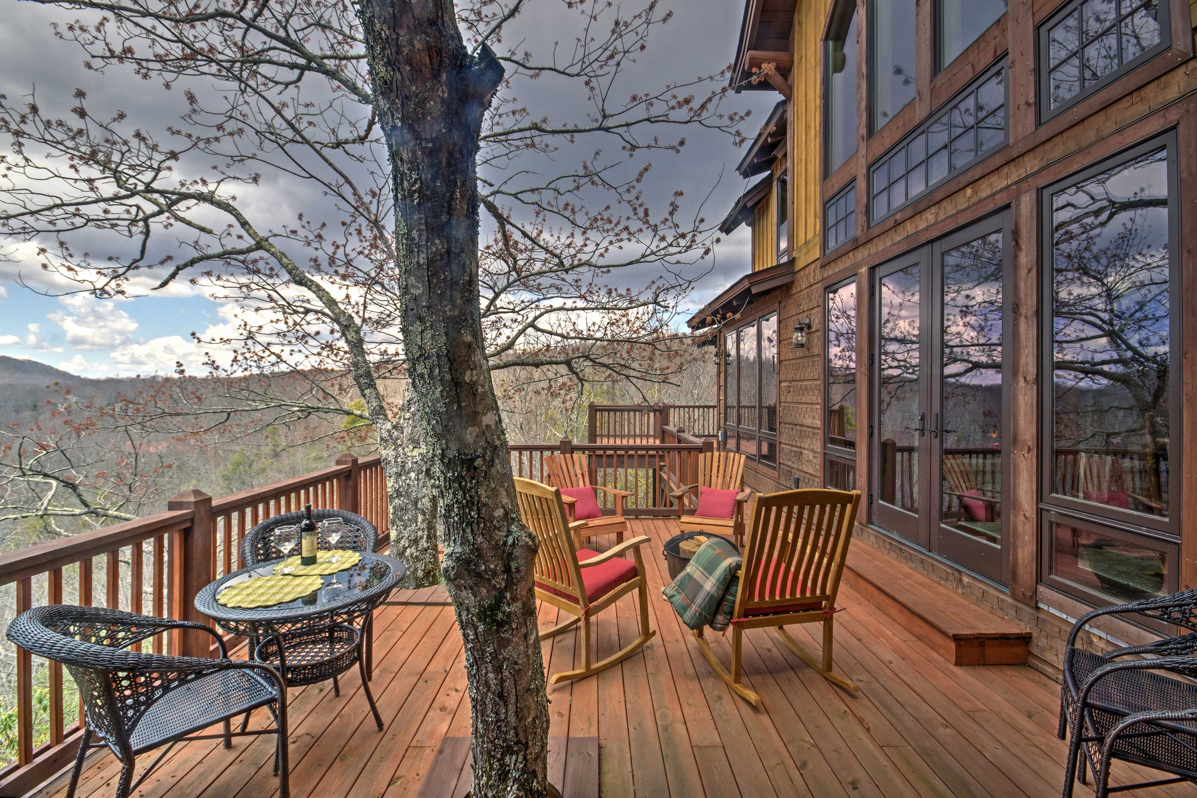 There's a gas and a wood-burning fire pit on the wraparound deck.