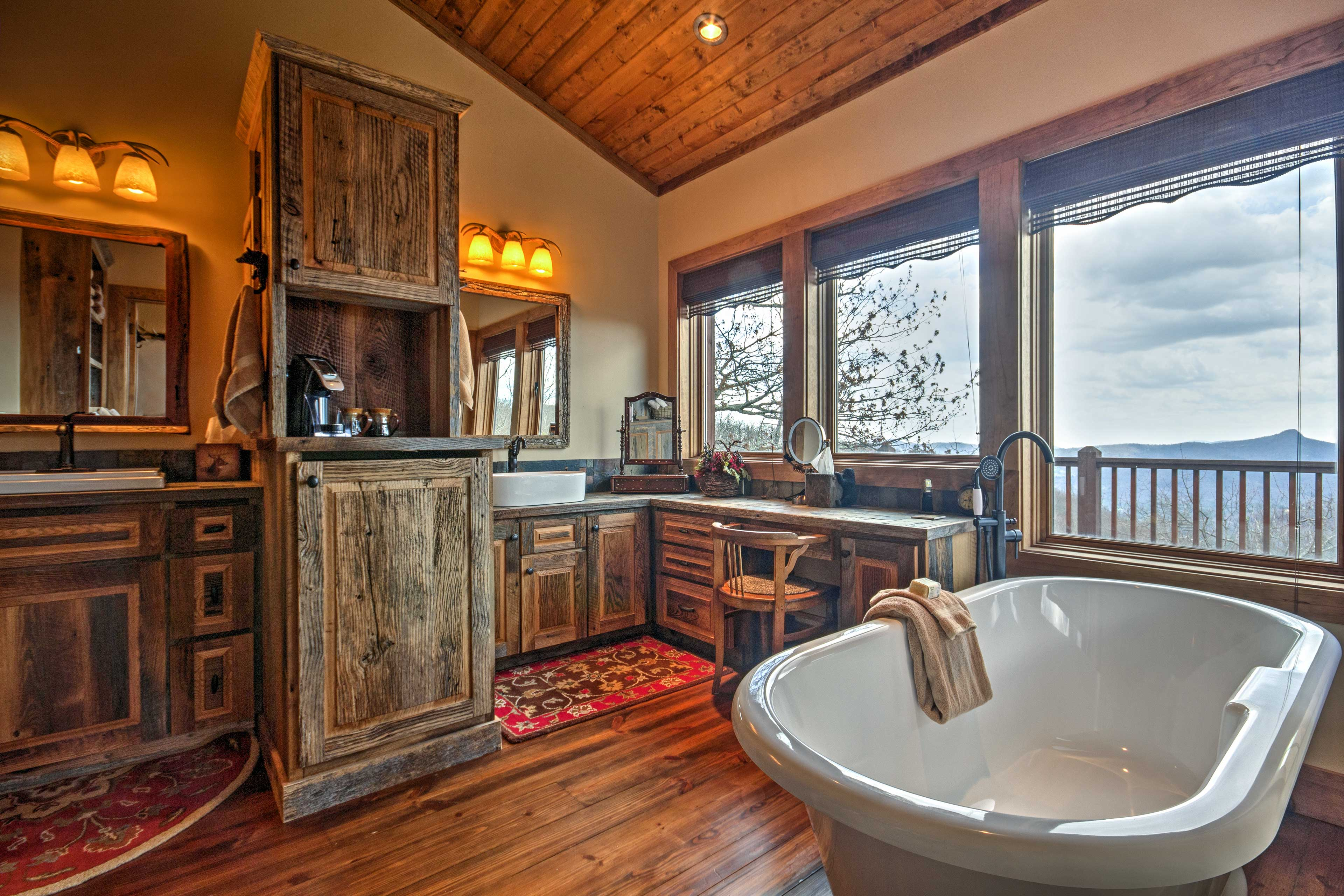 Soak your sore muscles in the elegant stand-alone bathtub.