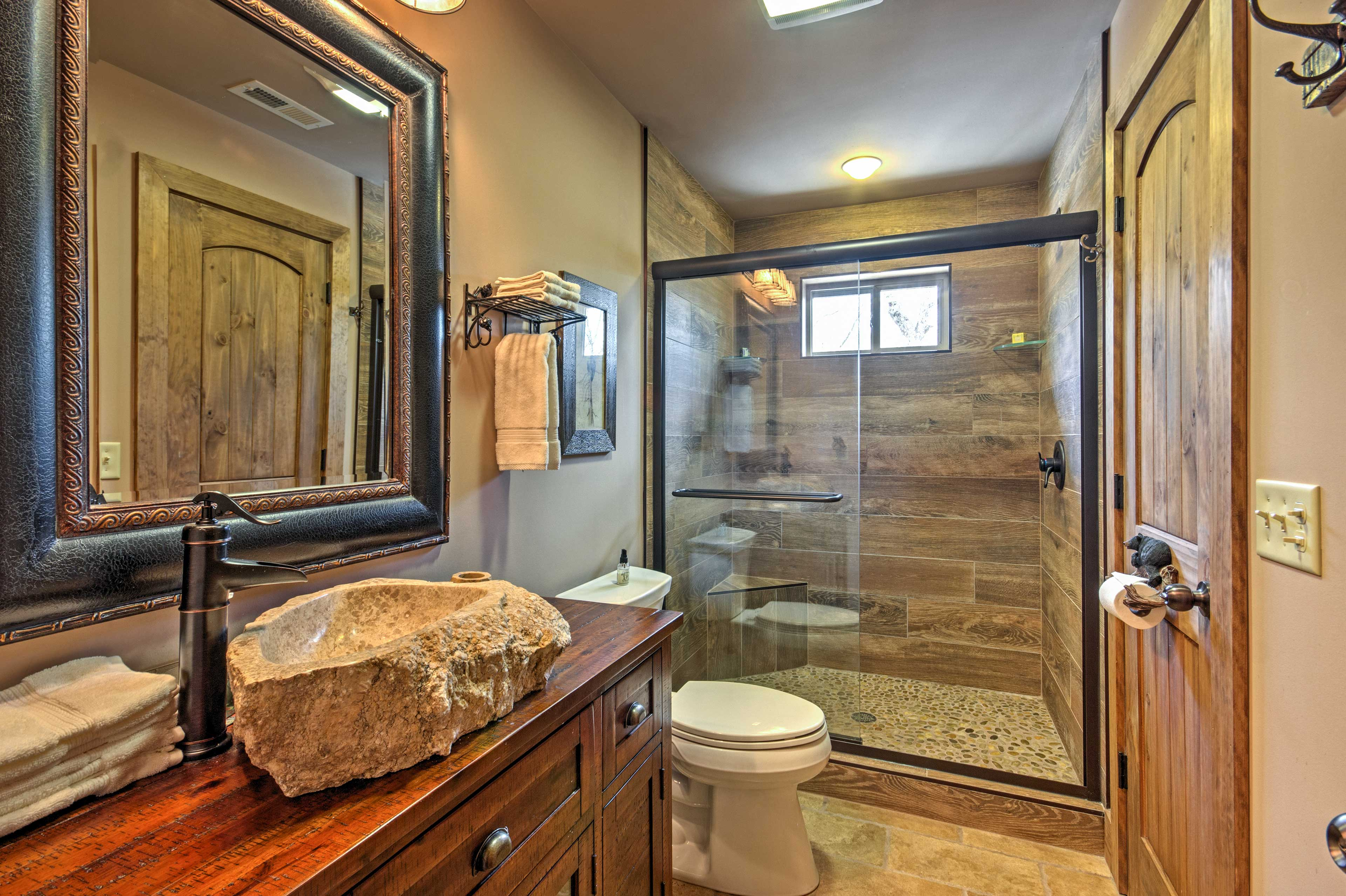 You'll love getting ready in this stunning bathroom.