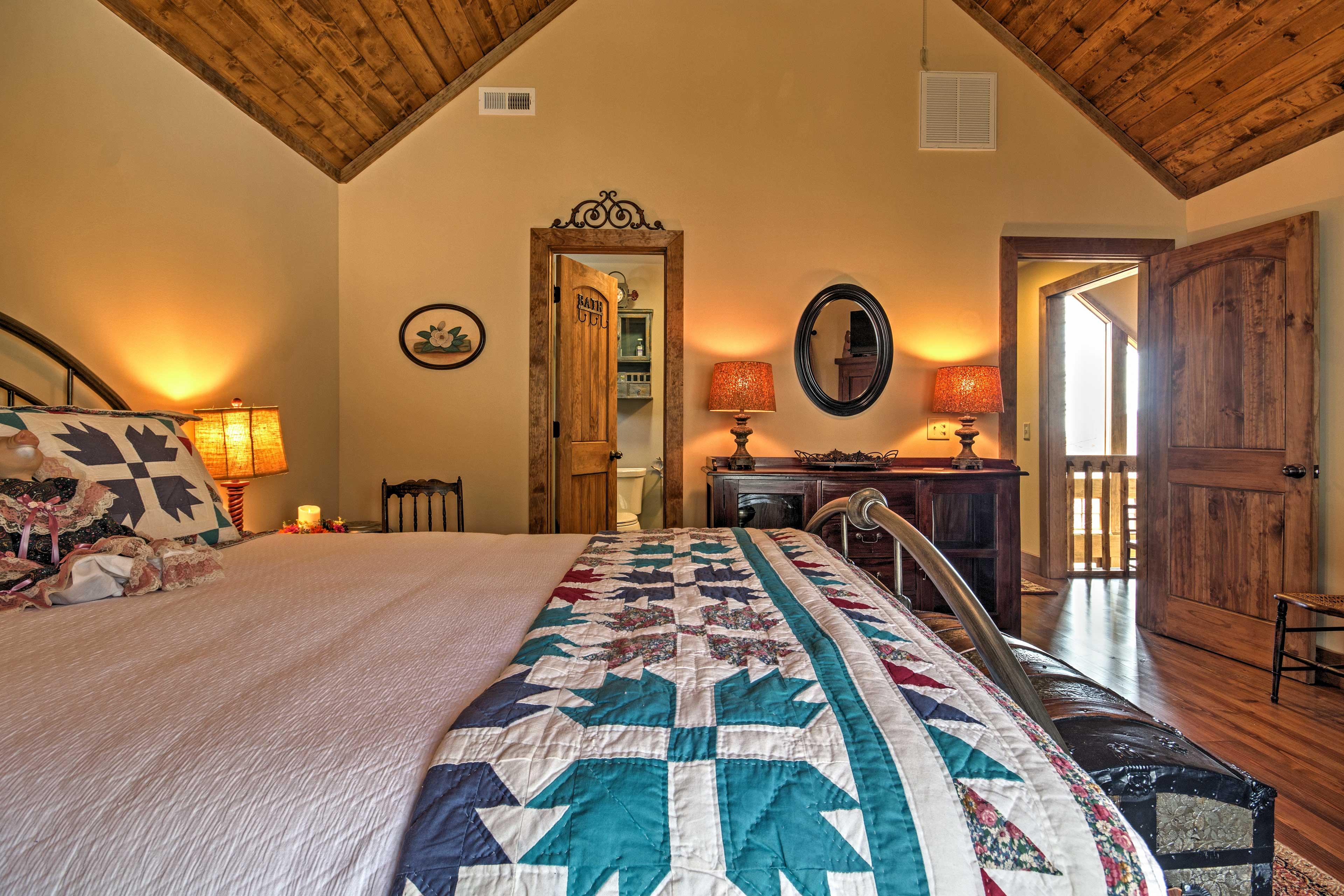 This bedroom has vaulted ceilings and an en-suite bathroom.