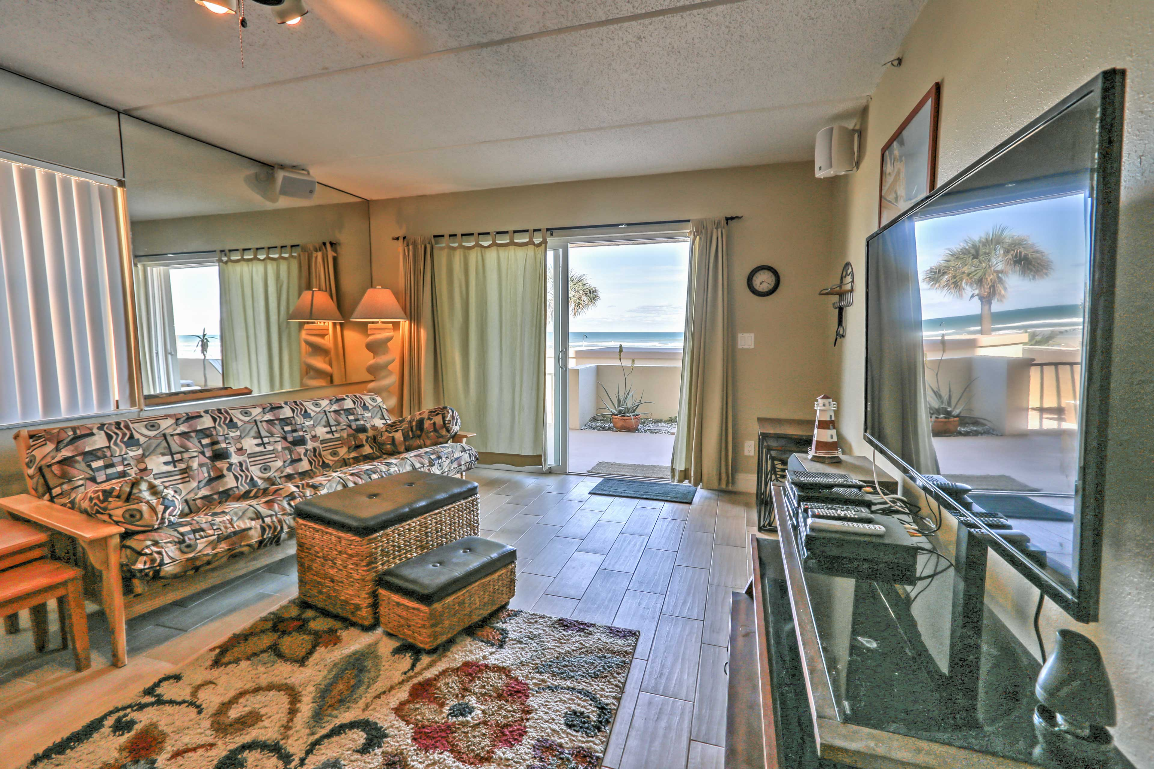 Lounge in the open living room and watch your favorite shows on the flat screen cable TV.