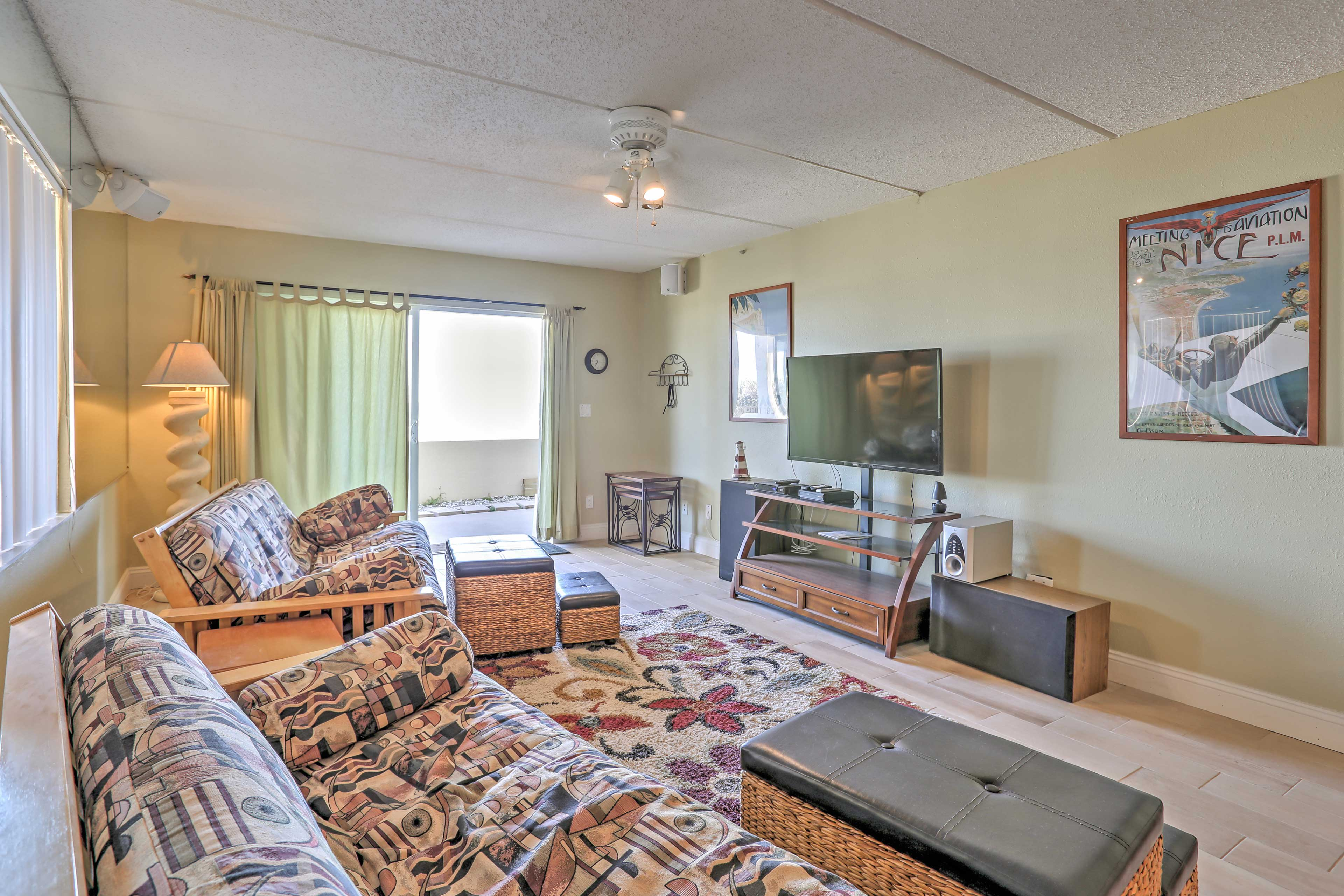 Looking for some fresh air? Open the sliding glass doors out to the patio as you relax in the living room.