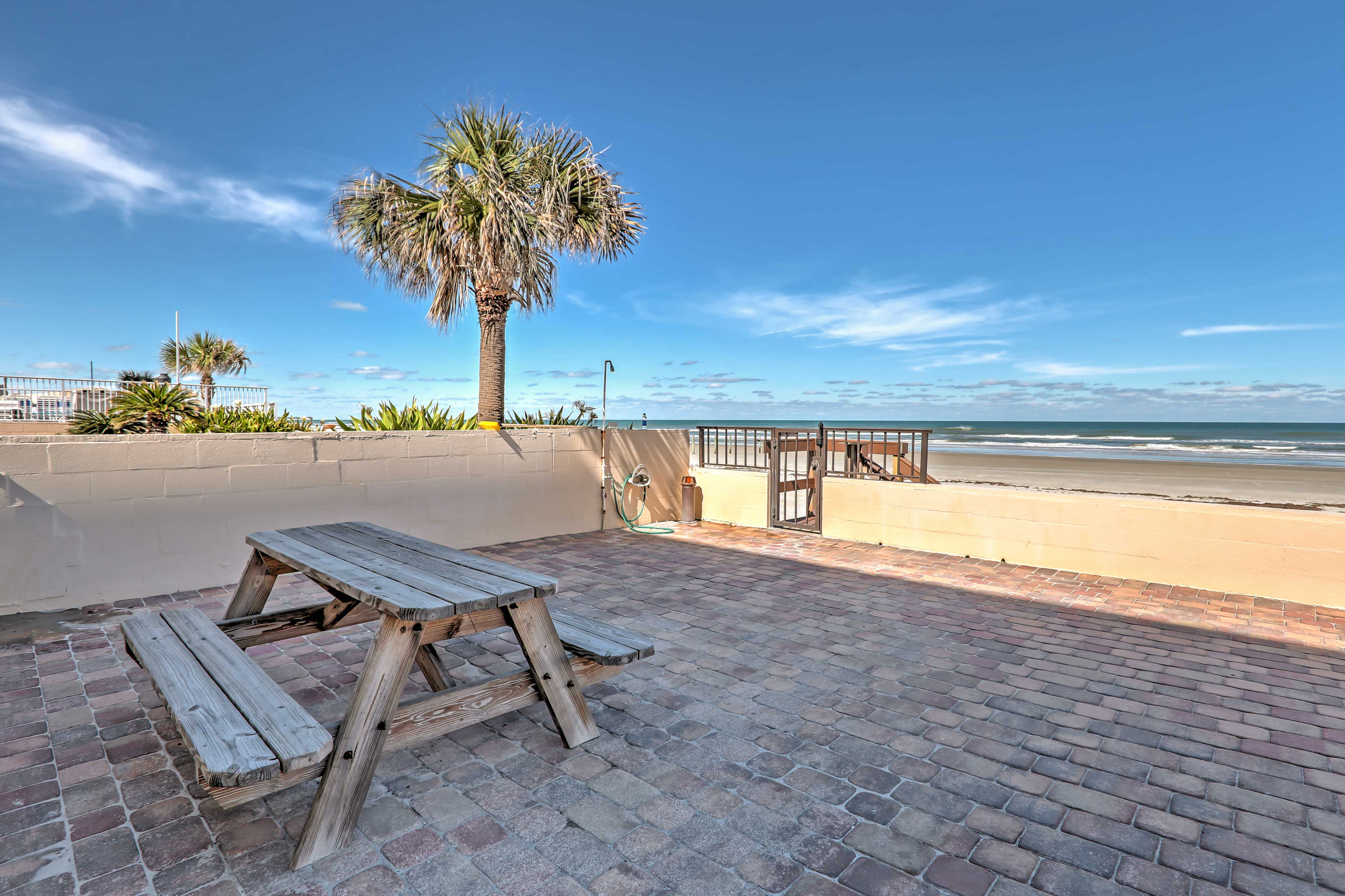 Only a few steps from the soft sand, this home provides endless fun in the sun.