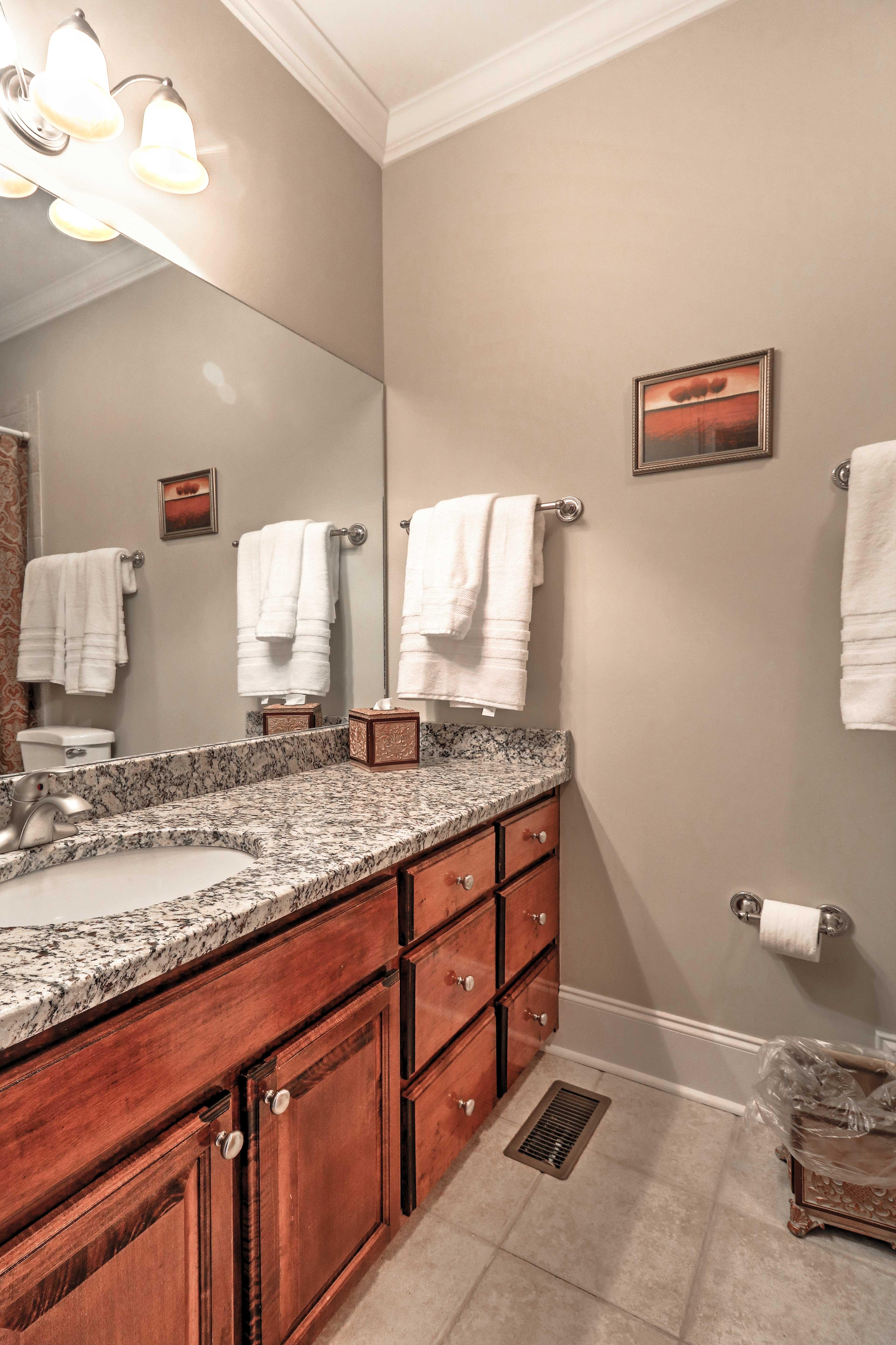 Complete nightly bedtime routines in this en-suite bathroom with granite countertops.