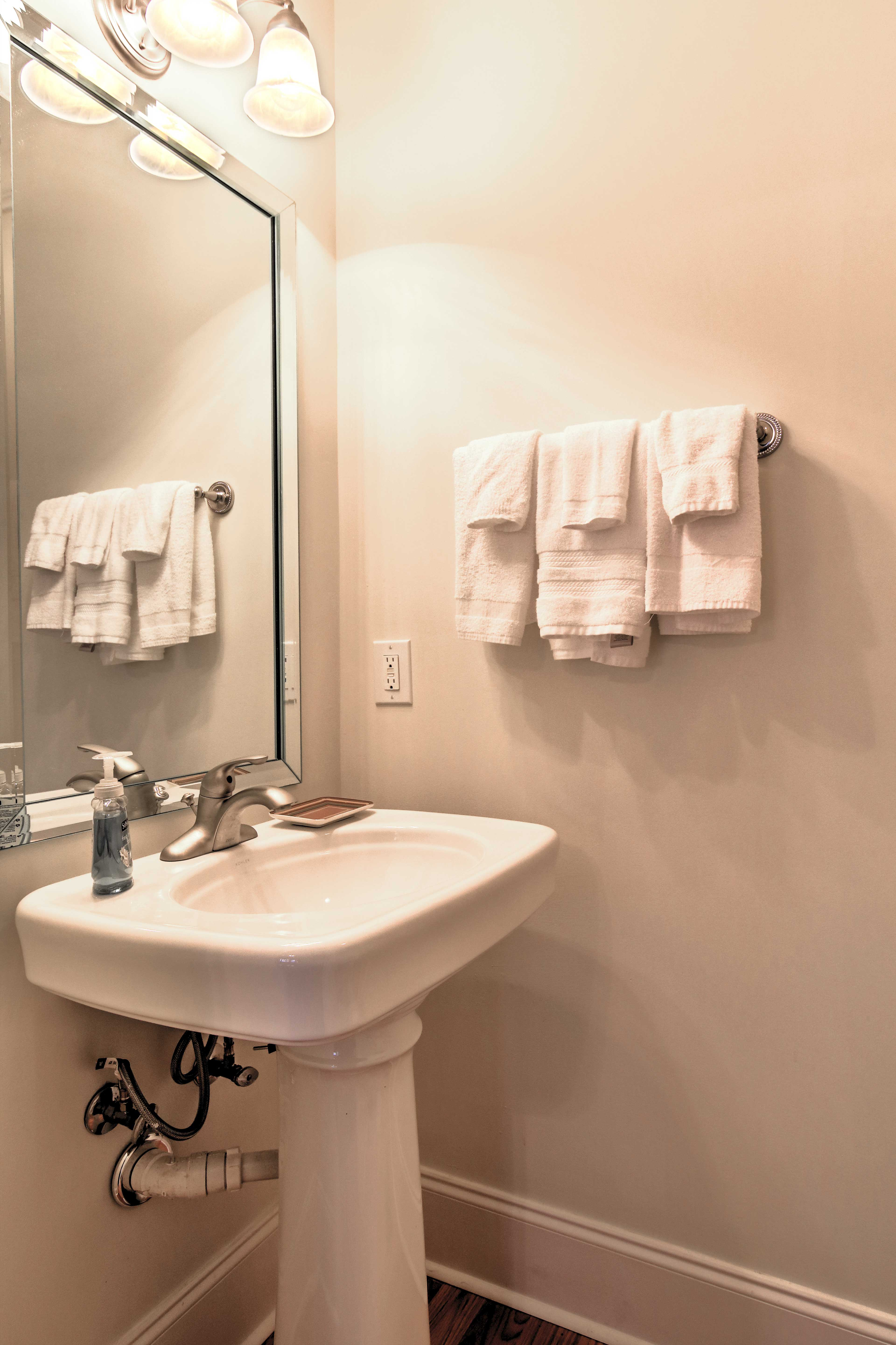 This half bath provides guests the perfect place to wash up for dinner!