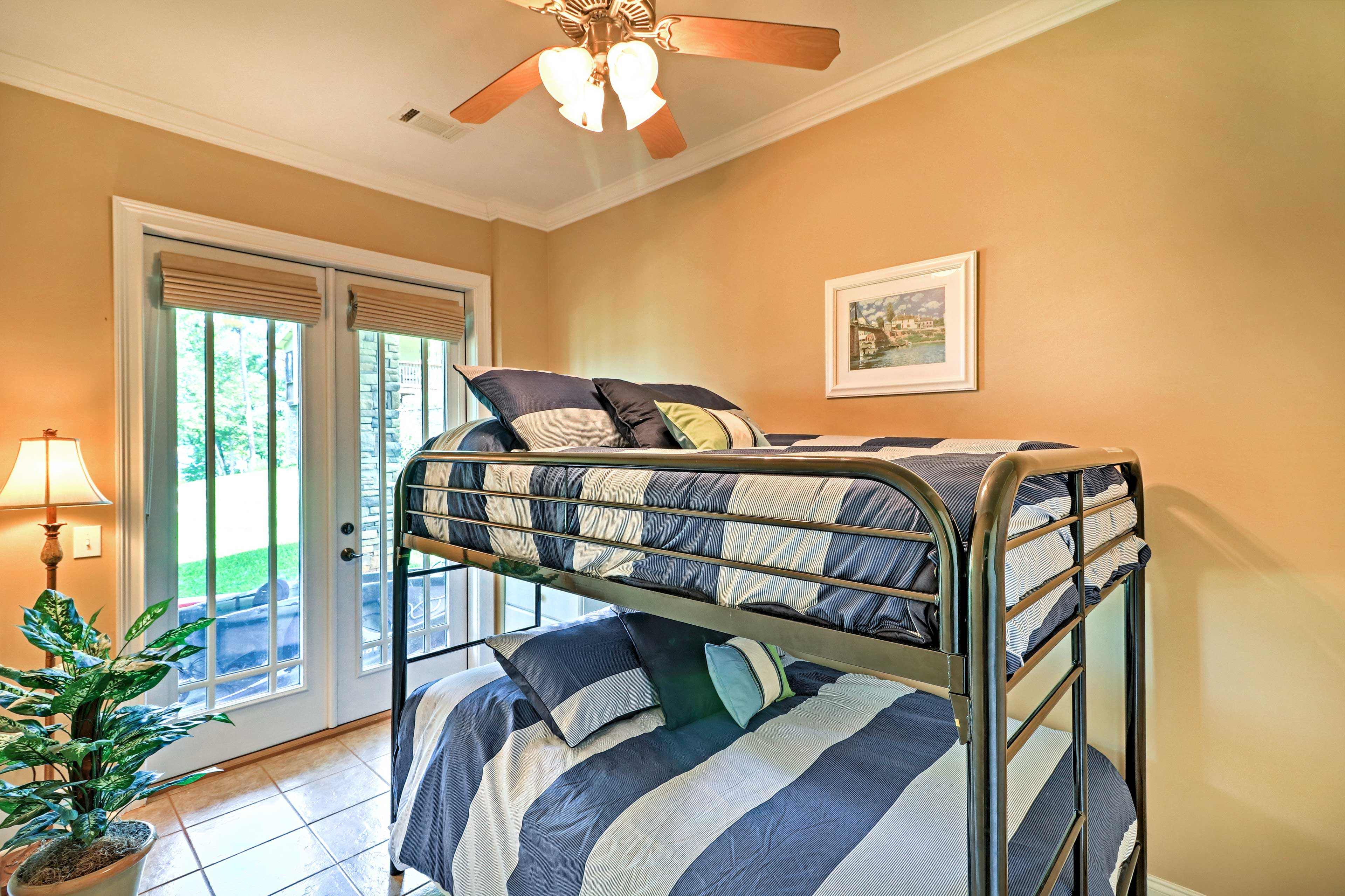 Kids will love staying in this room with full bunk beds.