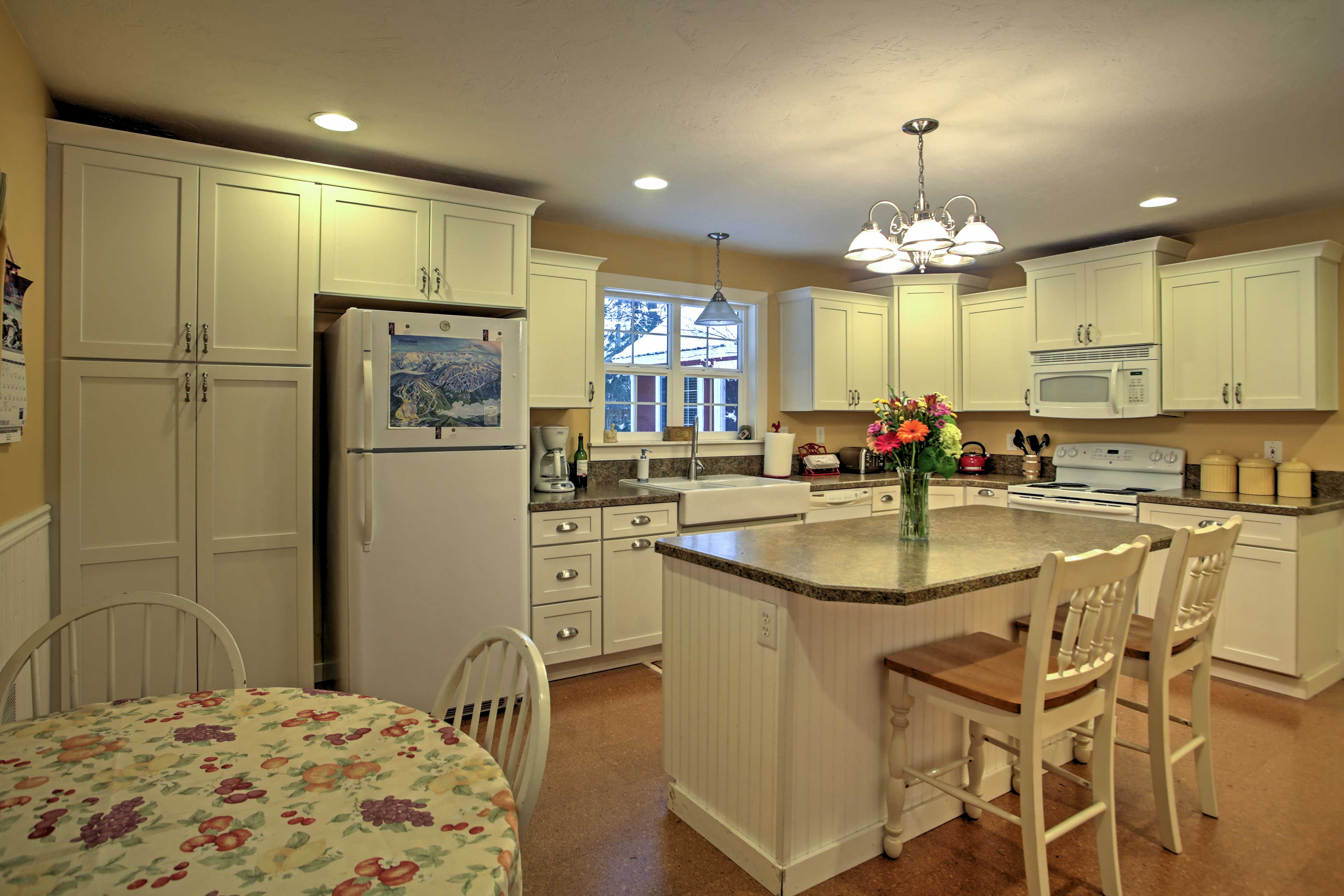 The large kitchen creates the perfect space to prepare your tasty meals.