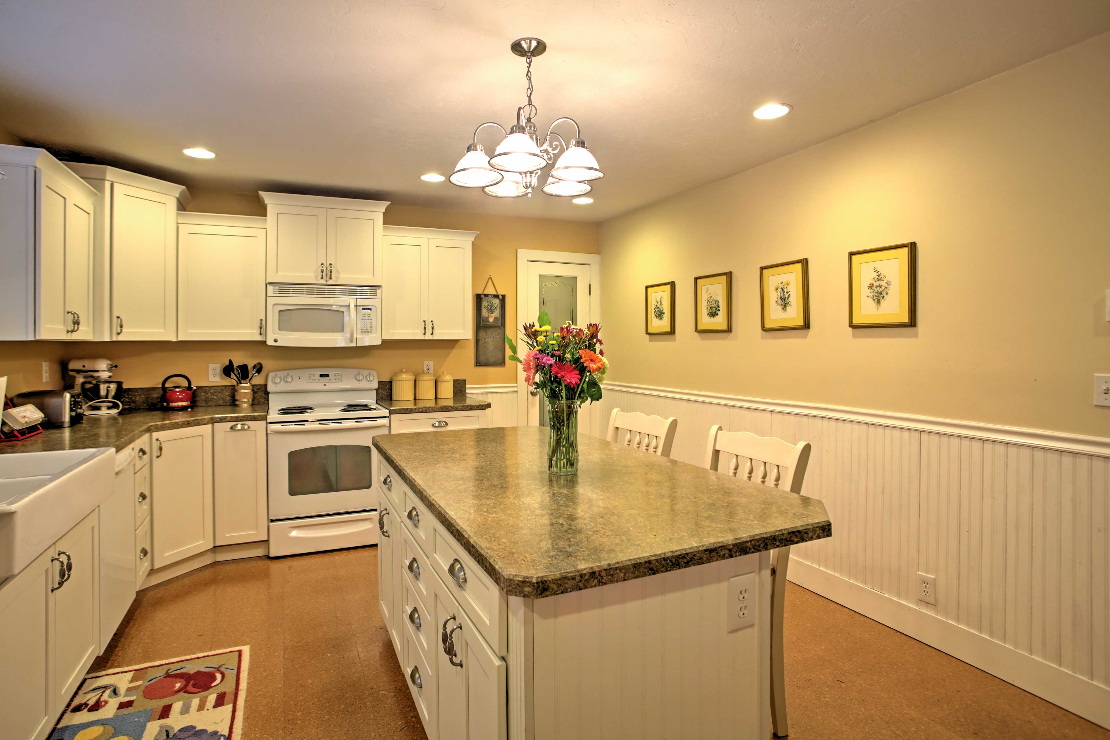 The island provides ample counterspace to work your cooking magic!