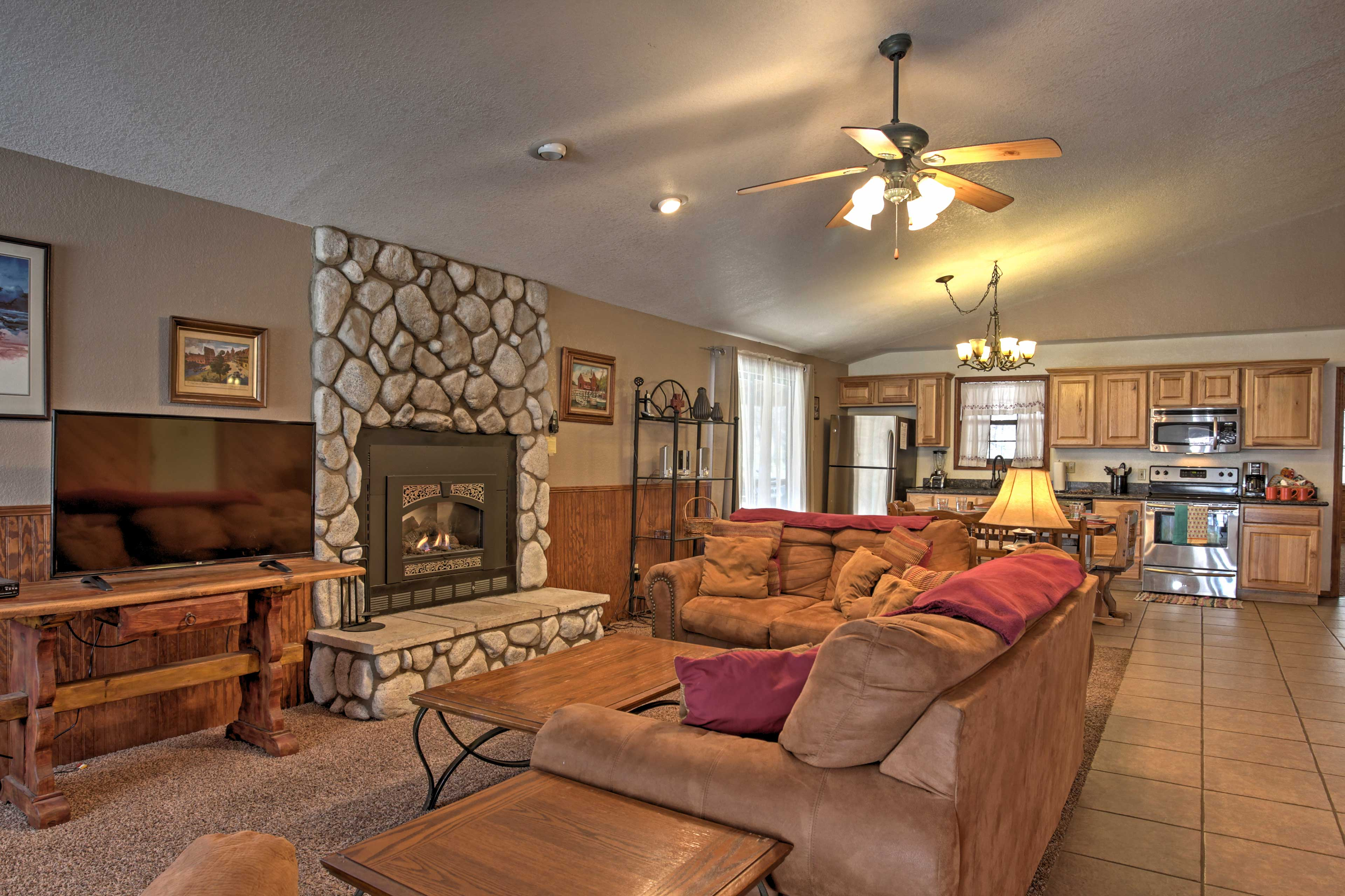 Unwind after a long day on the plush sofas. Pop in your favorite DVD and warm your toes by the fire!