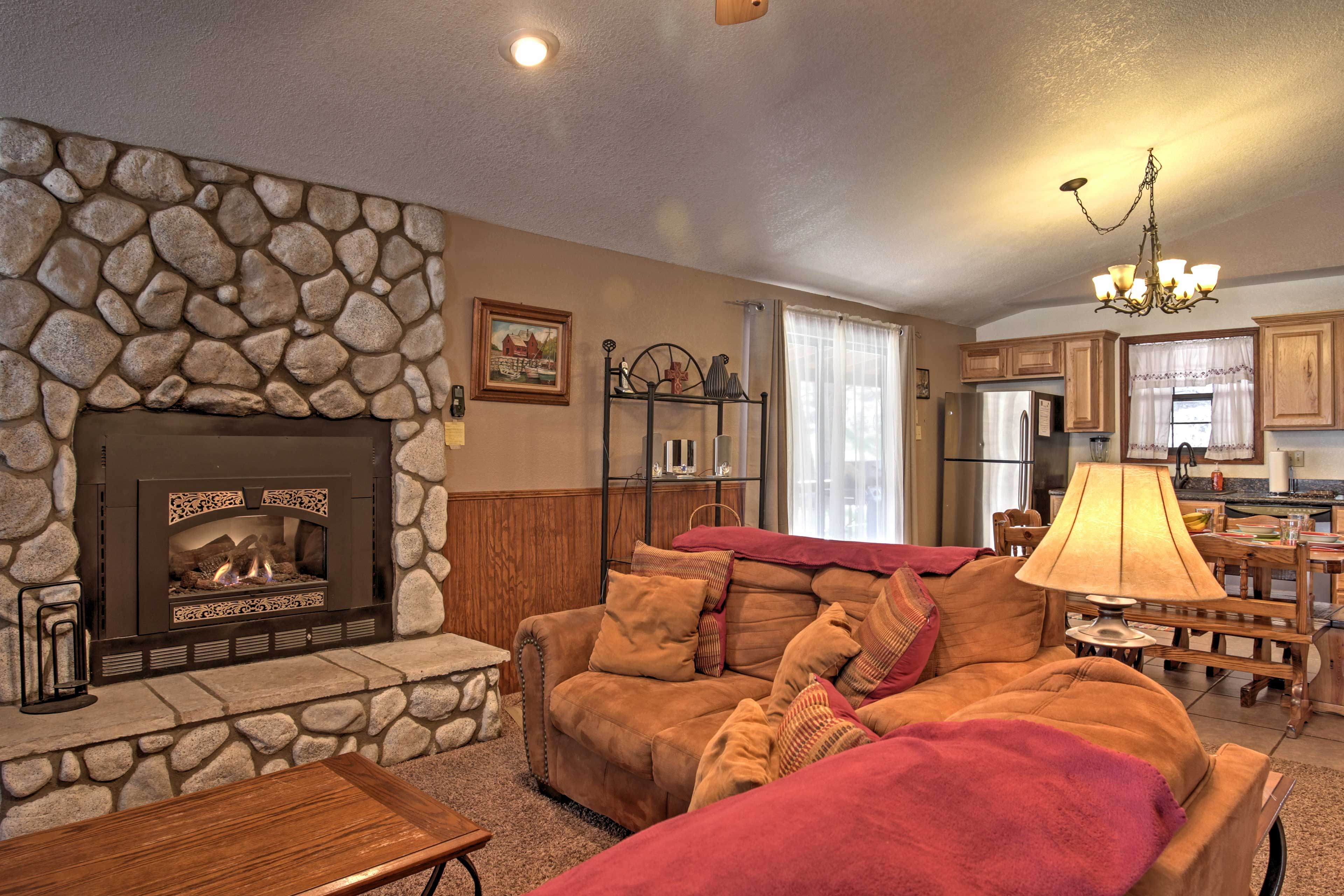 This exposed stone wall fireplace serves as the perfect centerpiece to this quaint home.