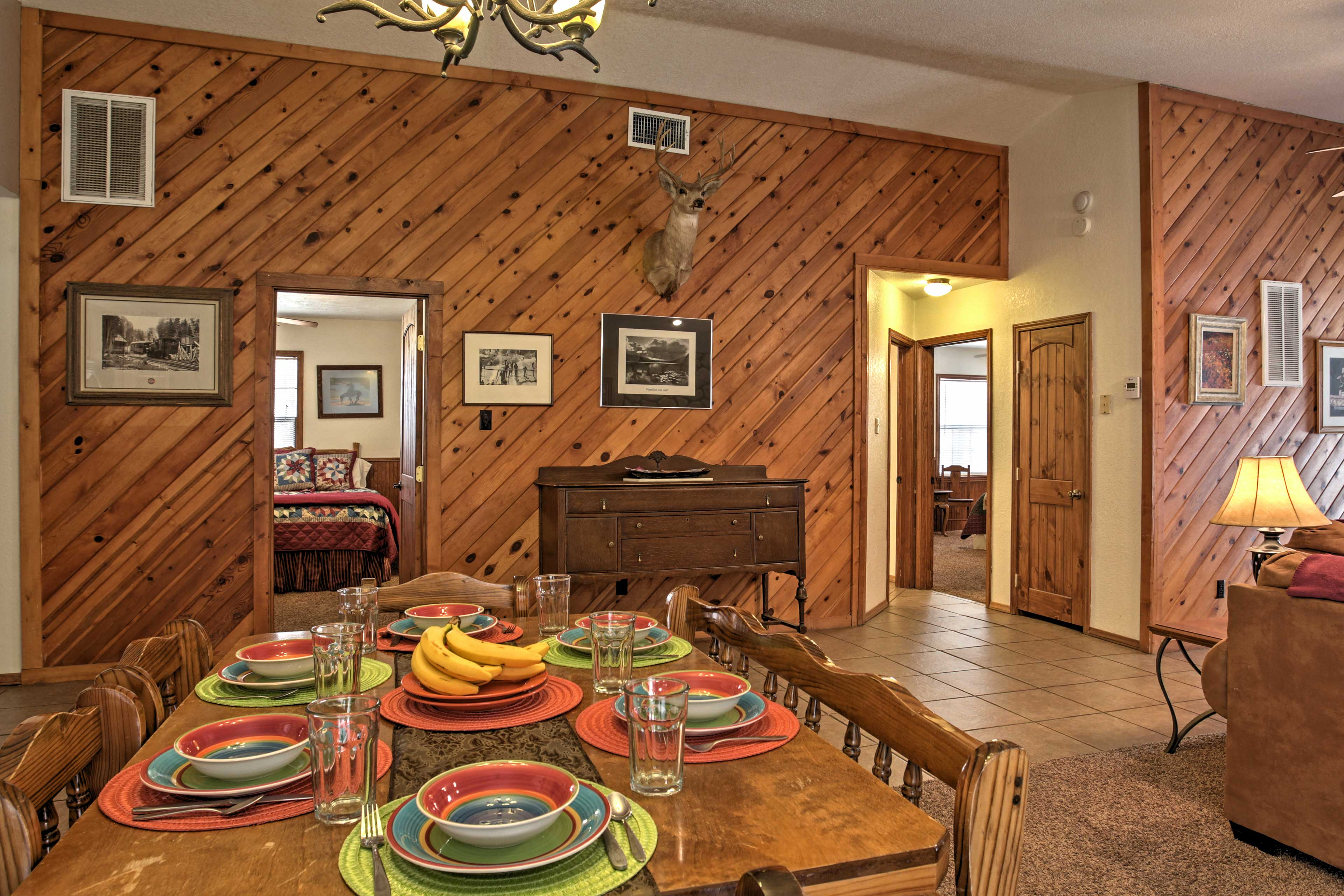 Gather around the community dining table with seating for 6-8 guests.