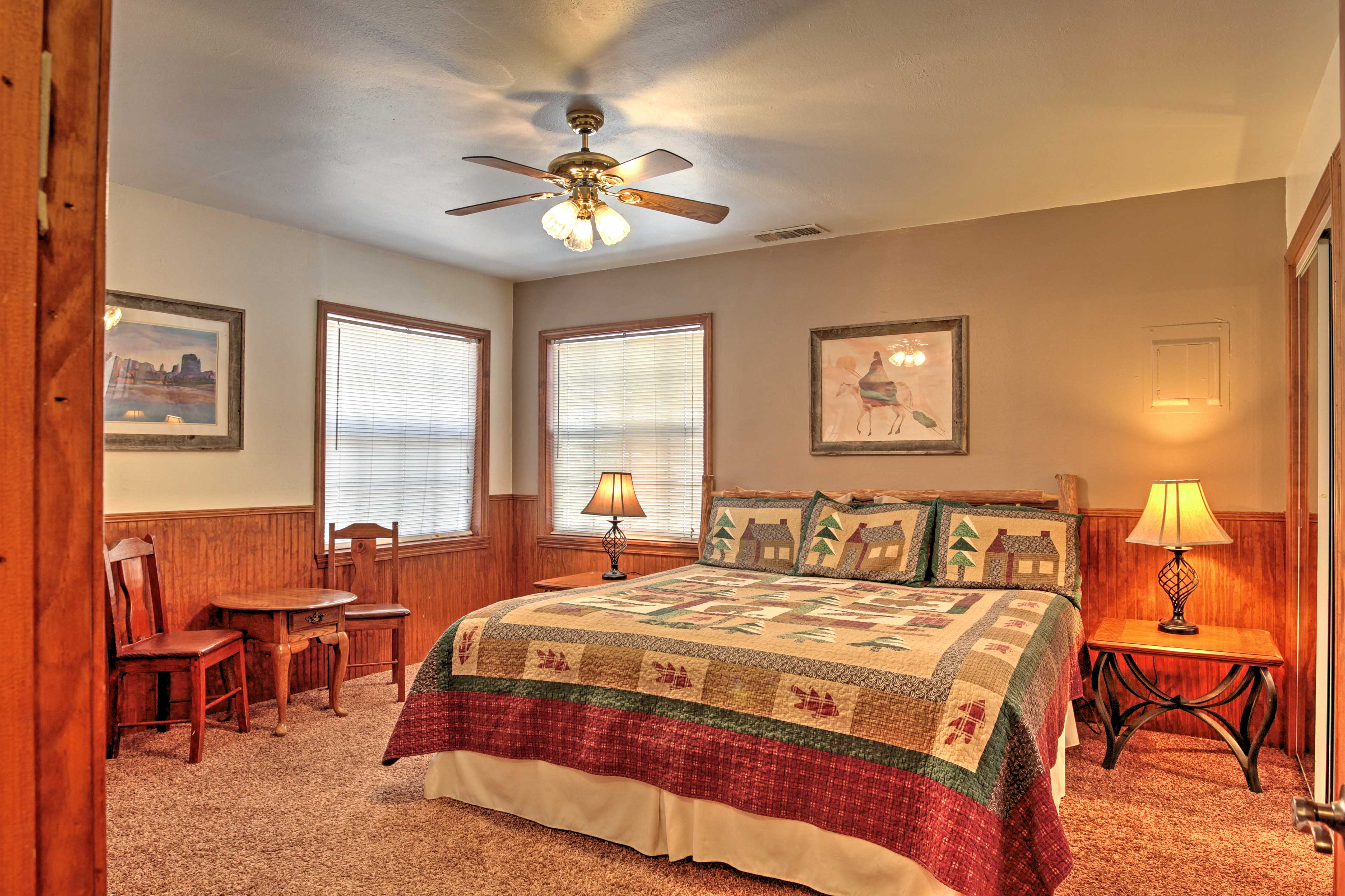 The master bedroom features a king-sized bed and ensuite bathroom.