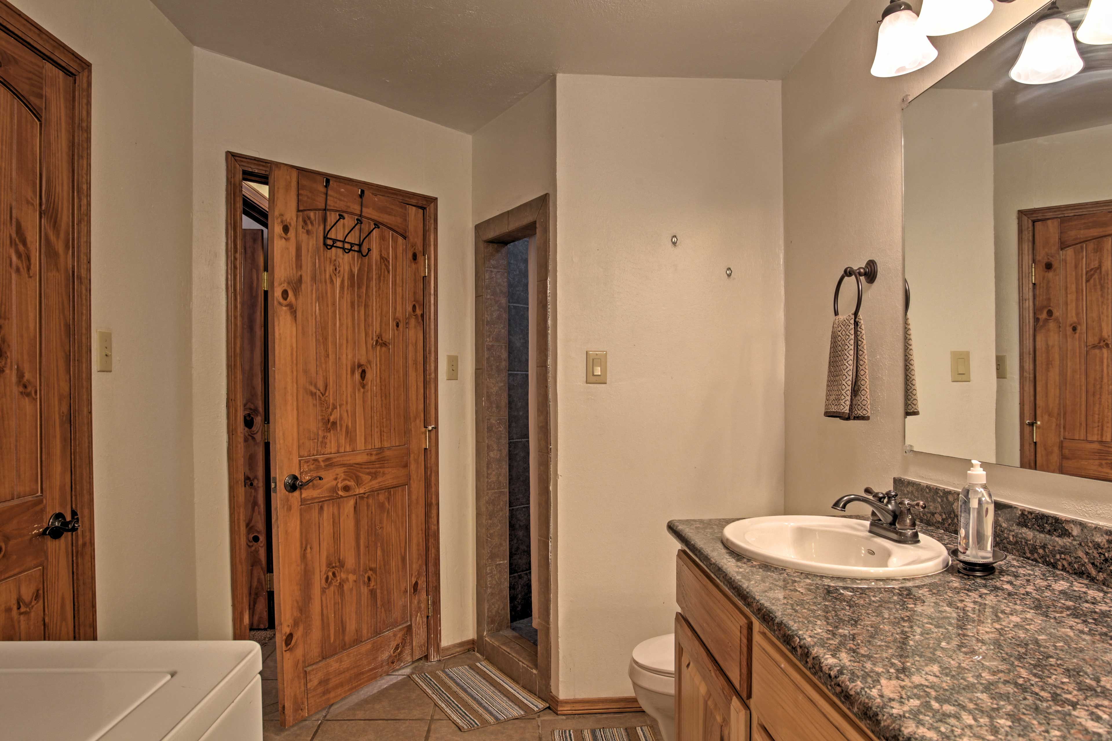 Get ready for bed as you wash off from the hot tub in the walk-in shower.