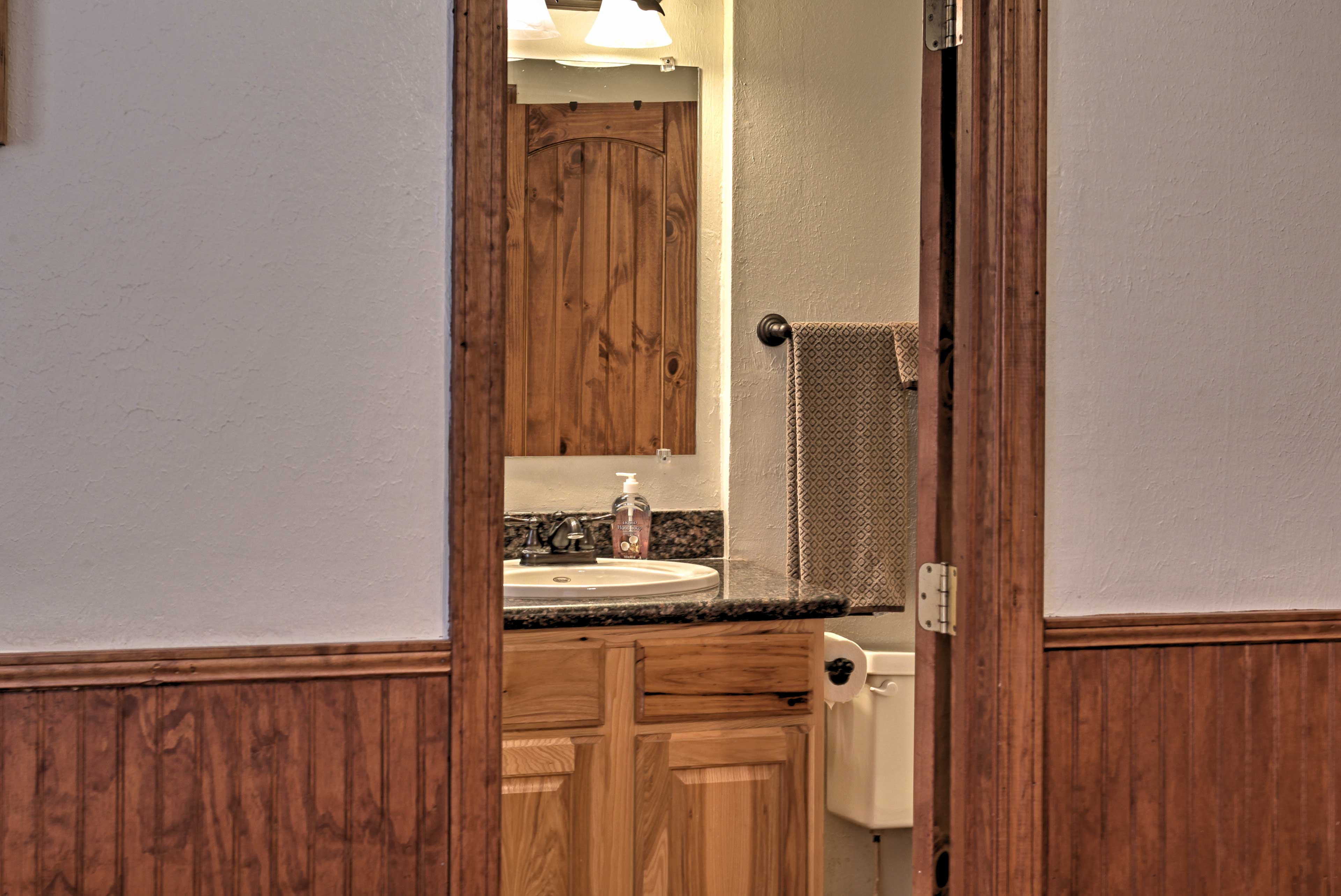 Conveniently located near the kitchen, guests can easily wash up for dinner!