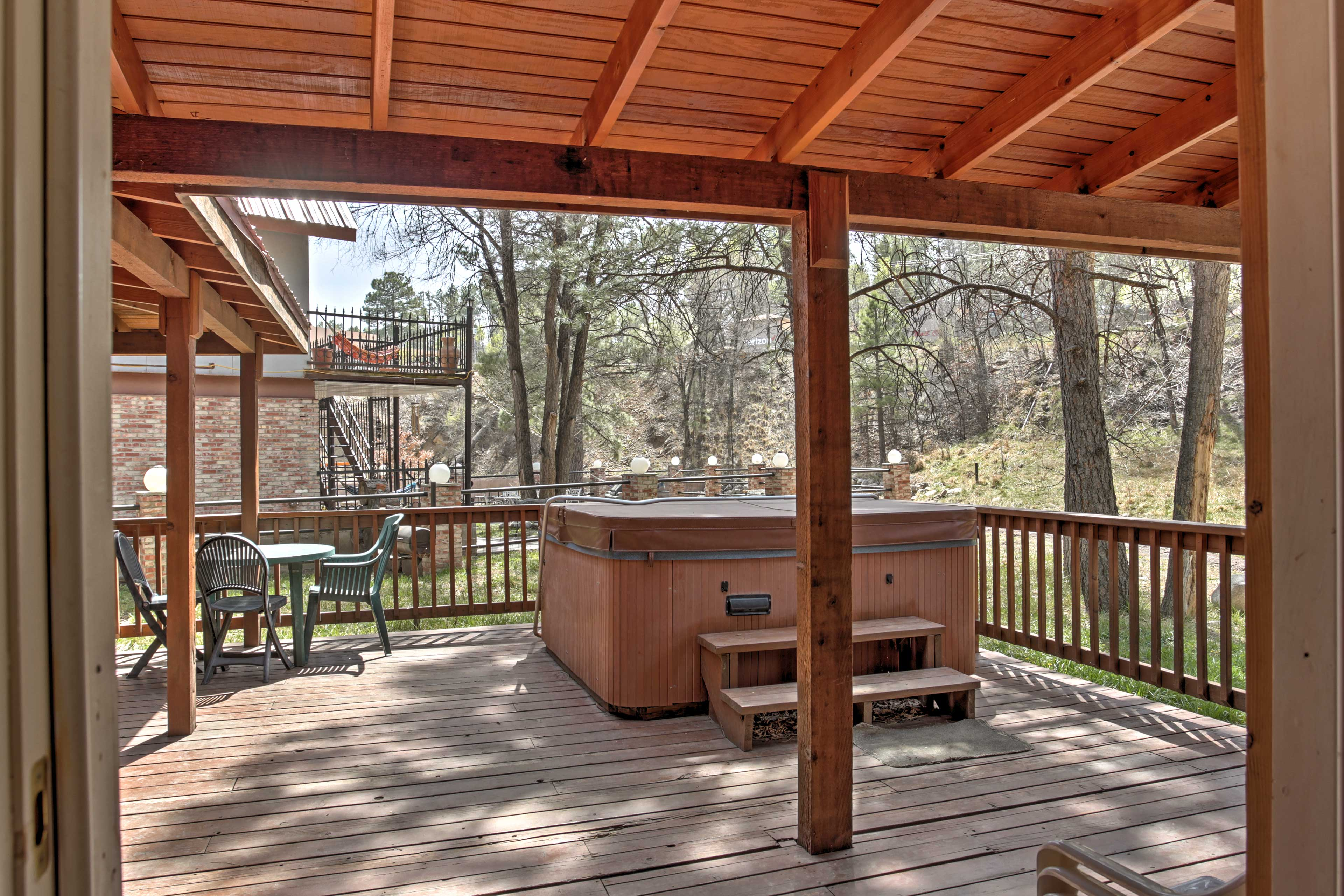 Overlook the beautiful wooded area as you relax outdoors.