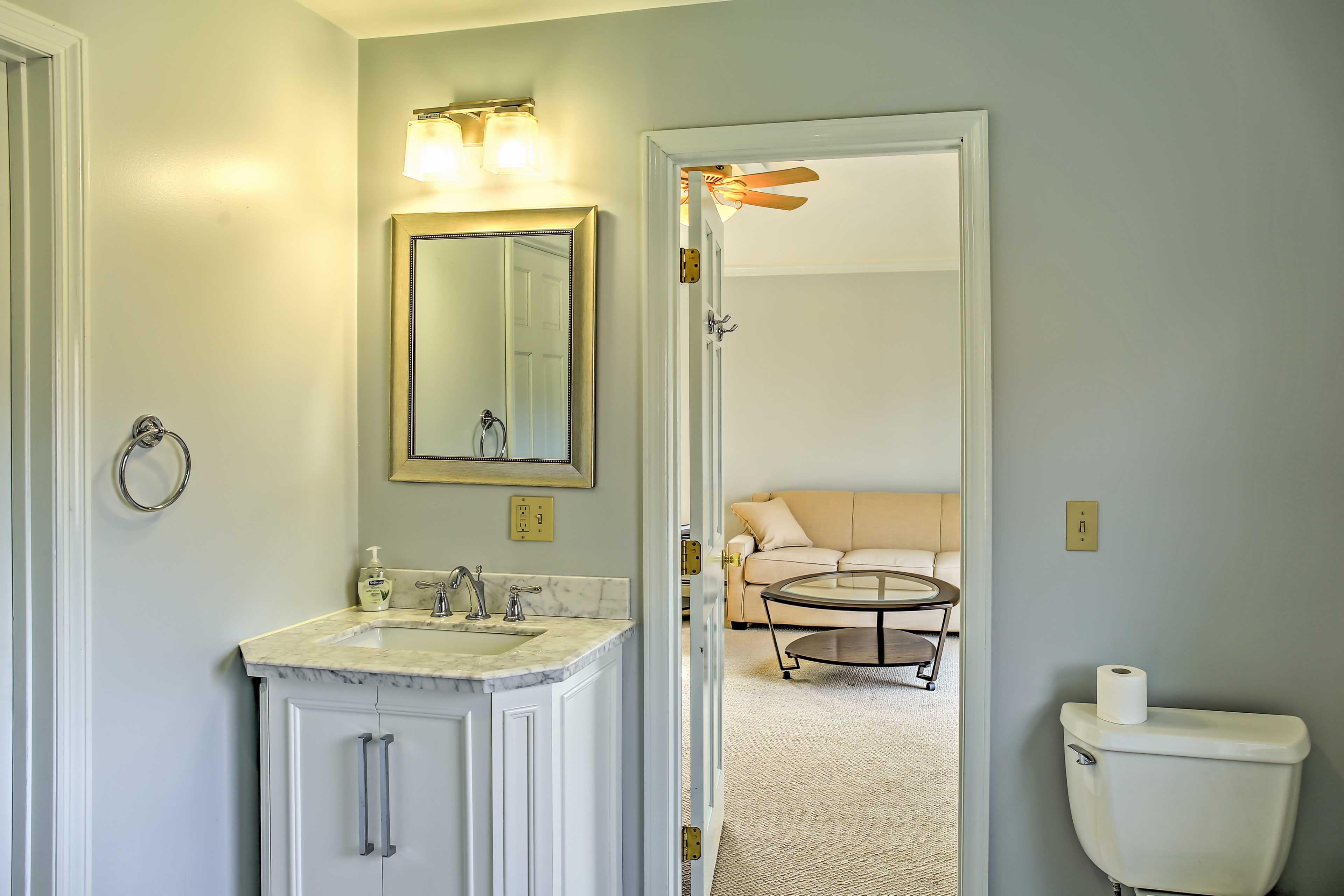 Freshen up in the master bedroom's en suite bathroom.