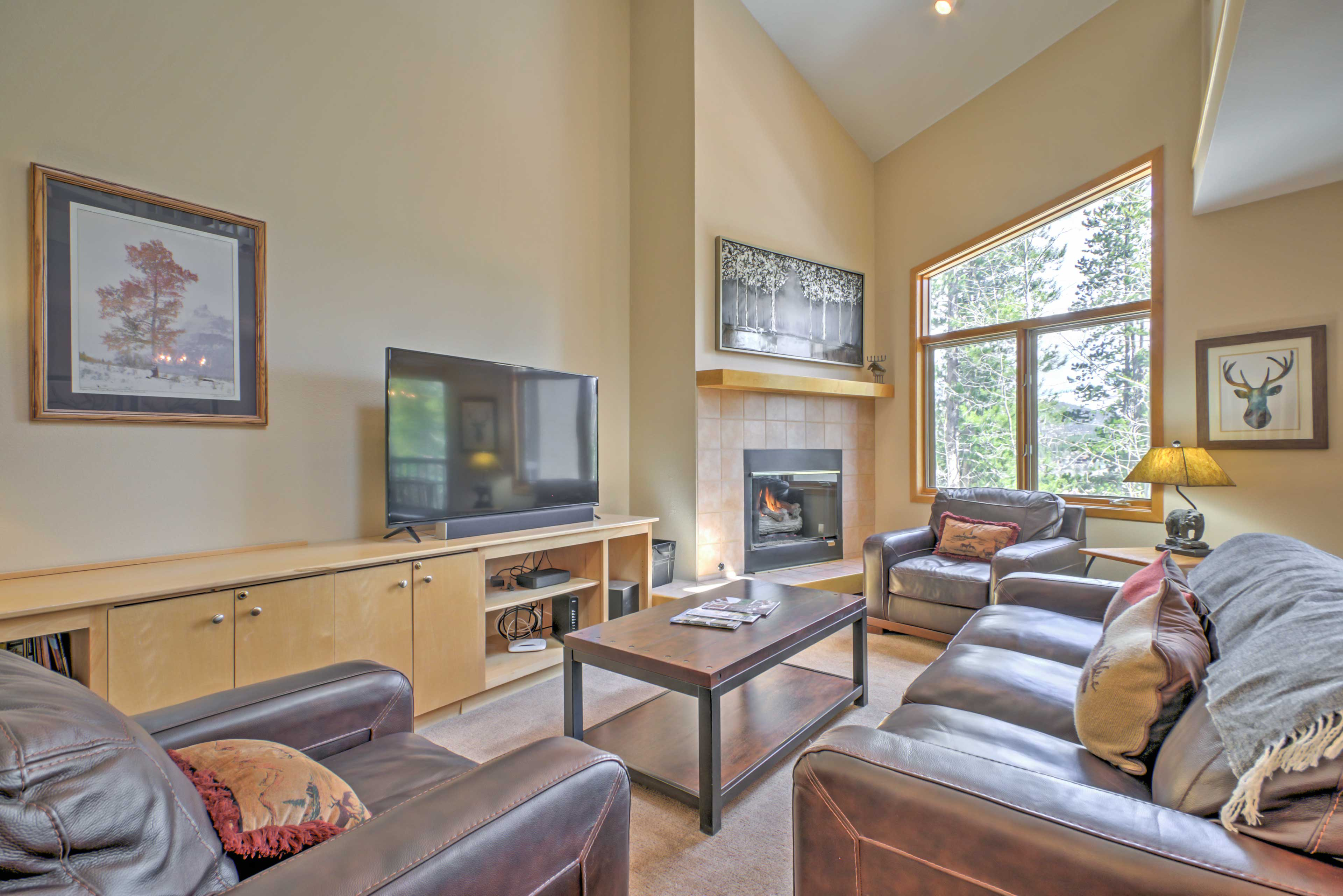 Unwind in front of the fireplace on the leather furnishings in the living room.