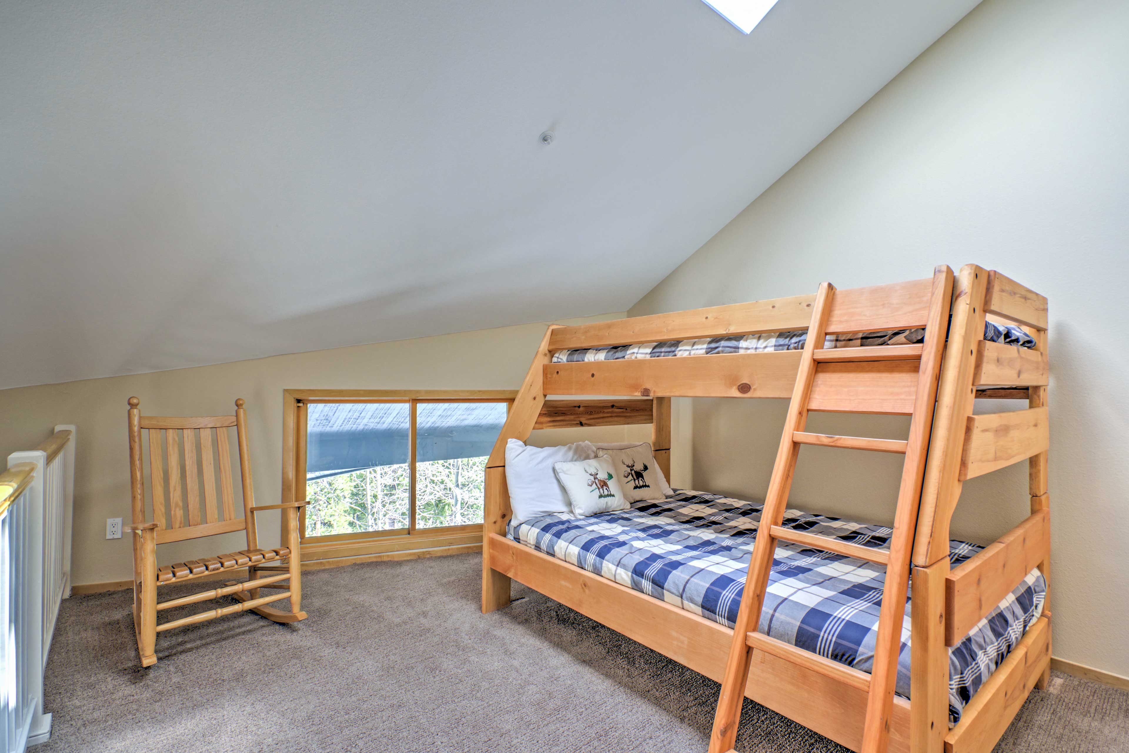 The loft area features a twin-over-full bunk bed that accommodates 3 guests!