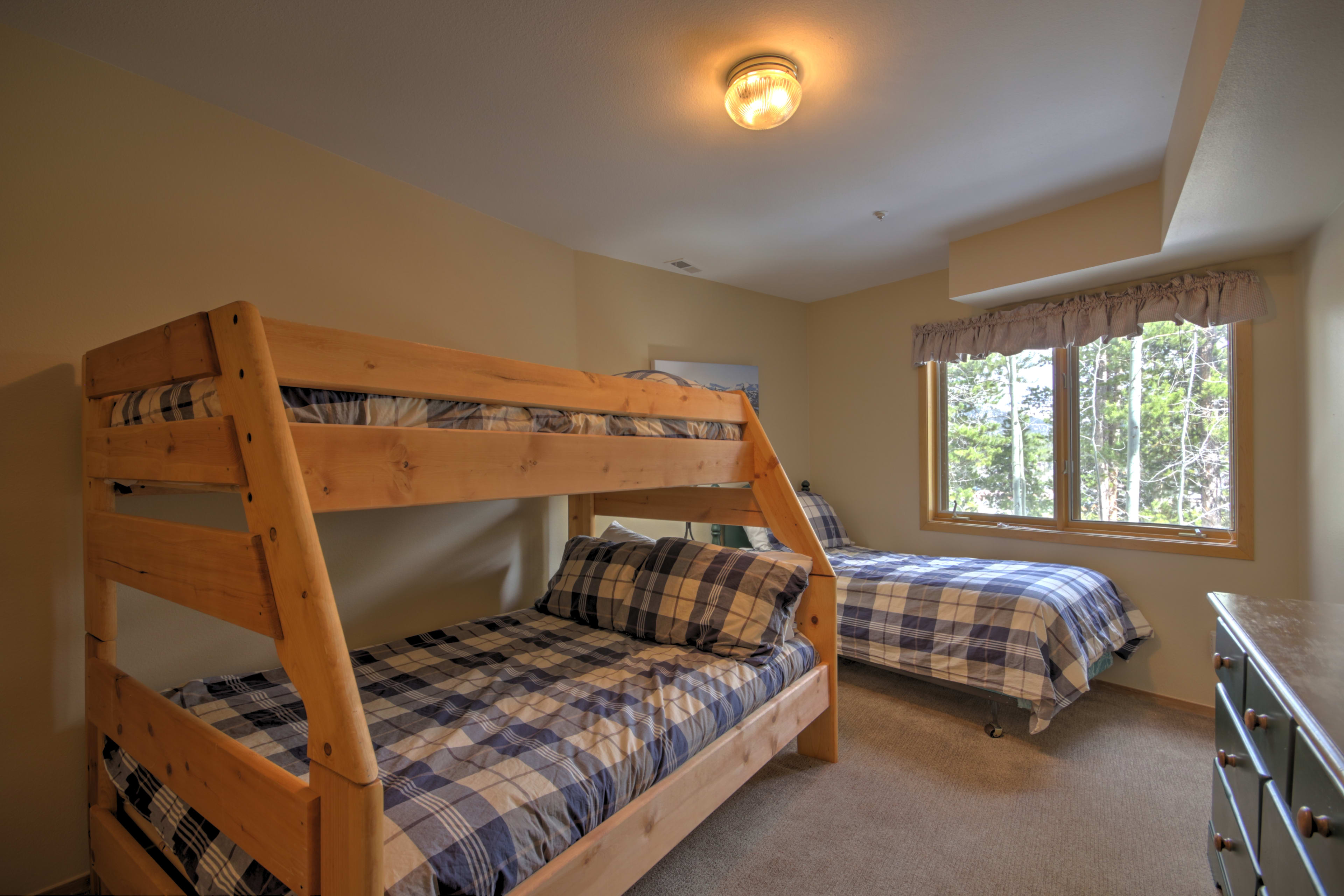 The downstairs bedroom features a bunk bed and twin bed - perfect for the kids!