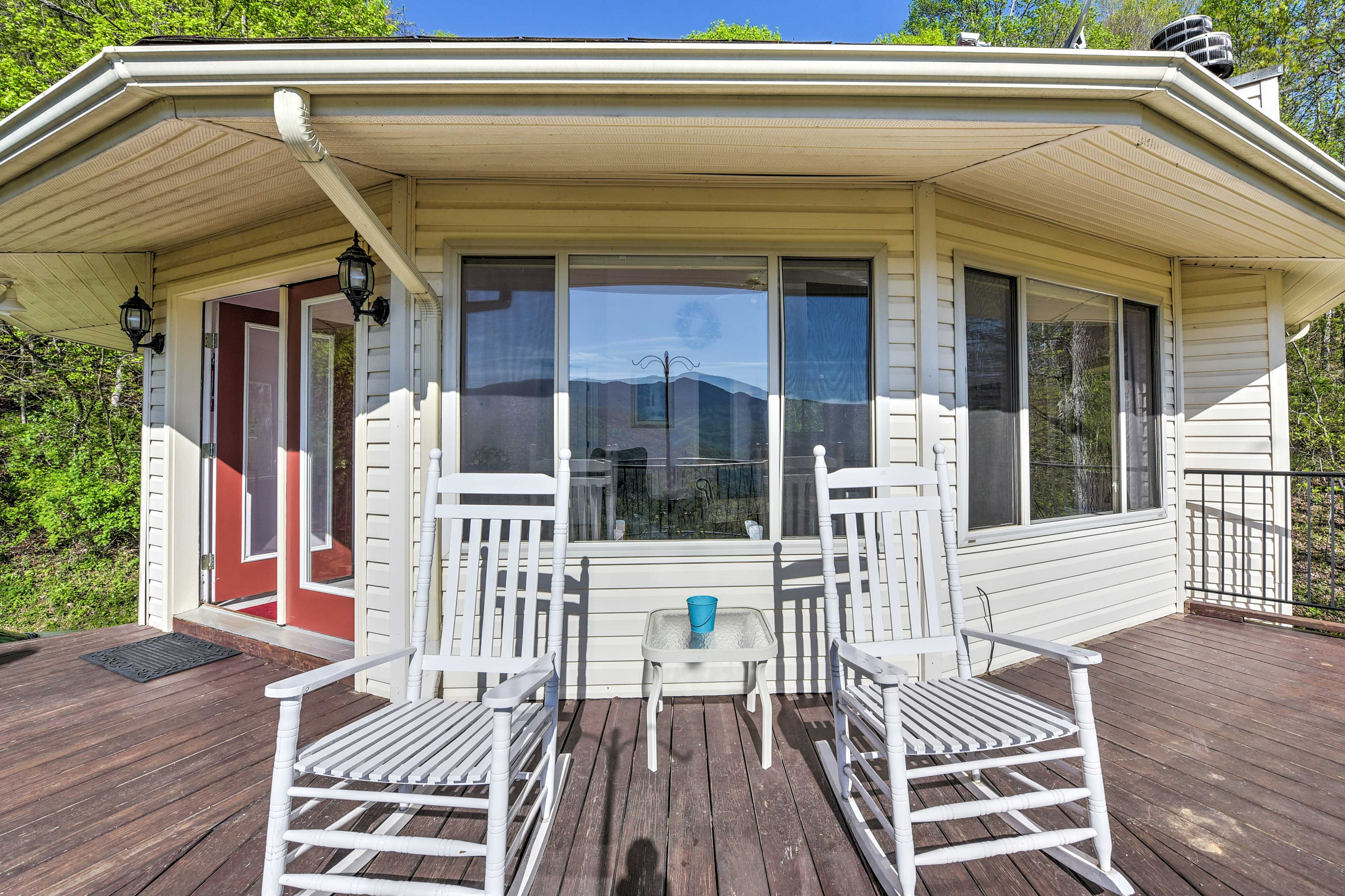Step outside to find a wraparound porch with rockers  and breathtaking views.
