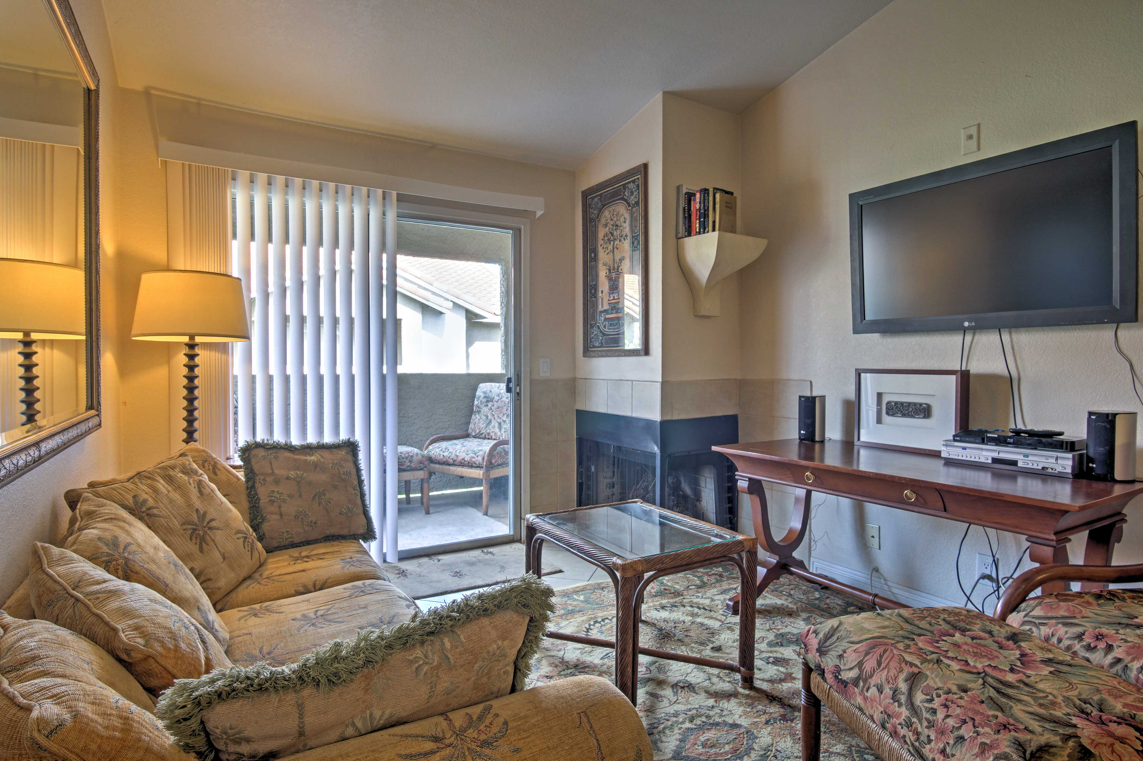 Warm up next to the wood-burning fireplace in the warm and inviting living room.