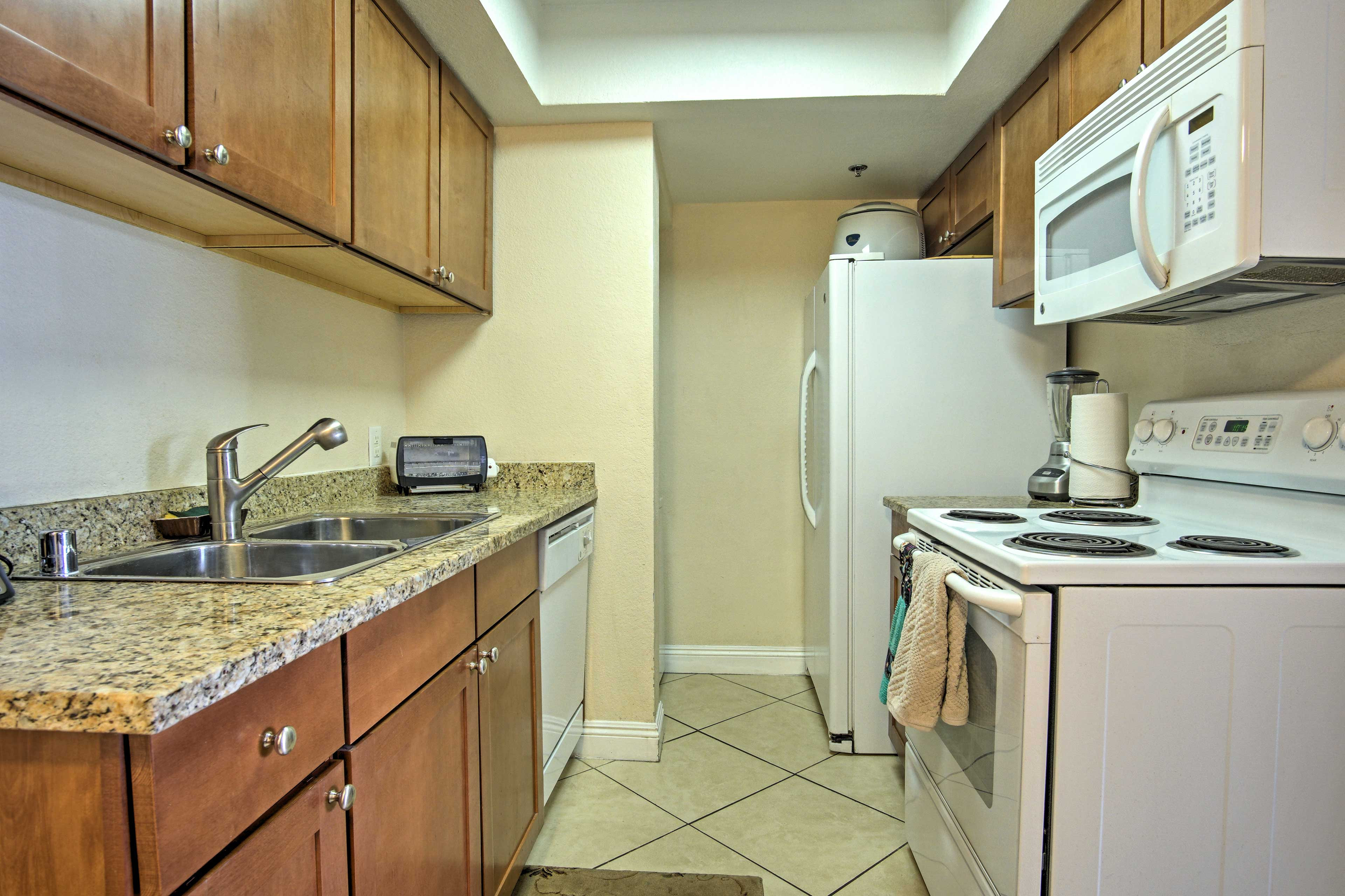 Utilize the ample granite counter space to meal prep.